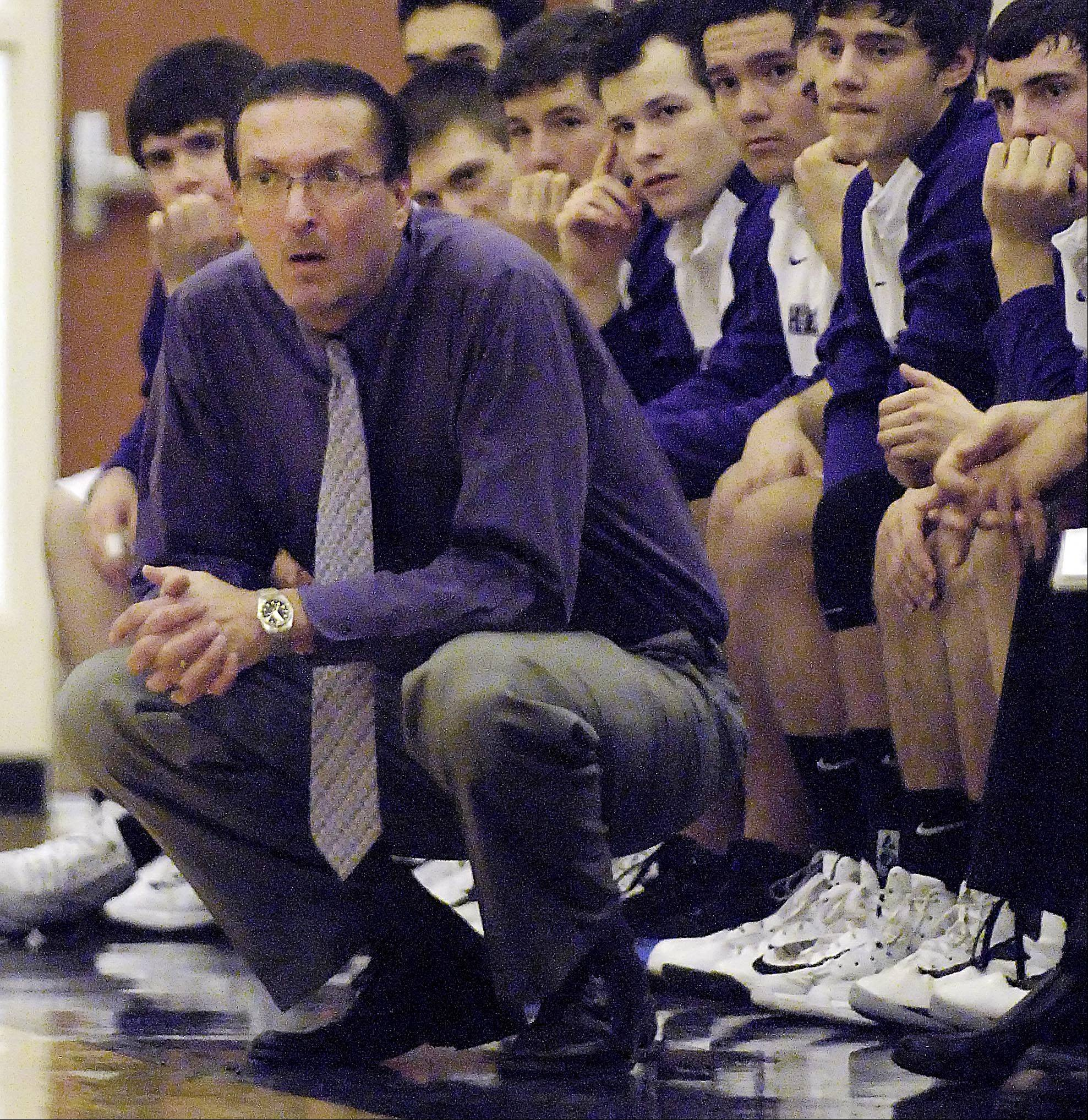 Hampshire coach Bob Barnett directs his team Tuesday in his first game of the season after suffering two heart attacks Nov. 20.