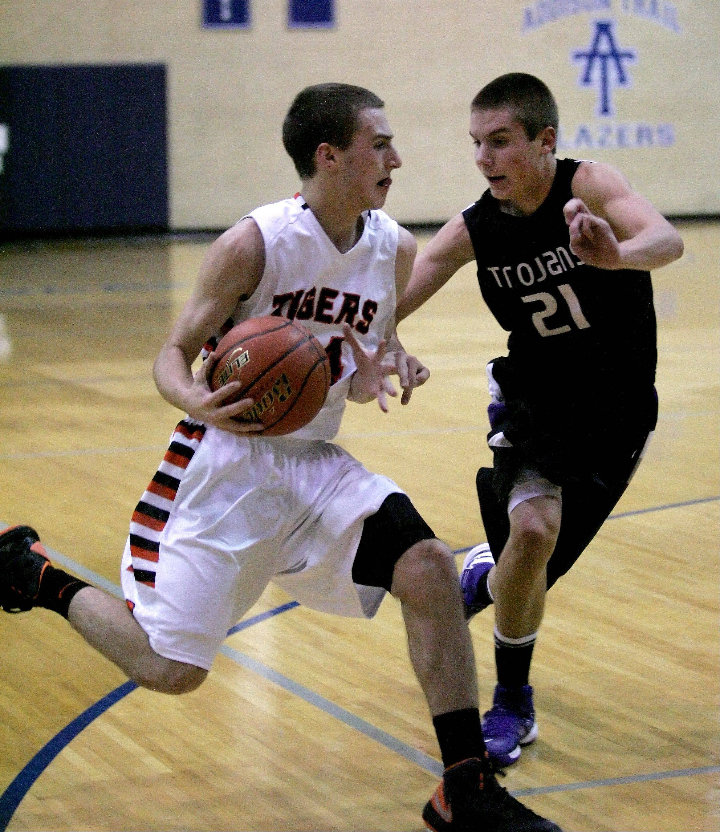 Matt Kienzle of Wheaton Warrenville South, left, moves around David Henson of Downers Grove North in boys basketball action on Tuesday in Addison.