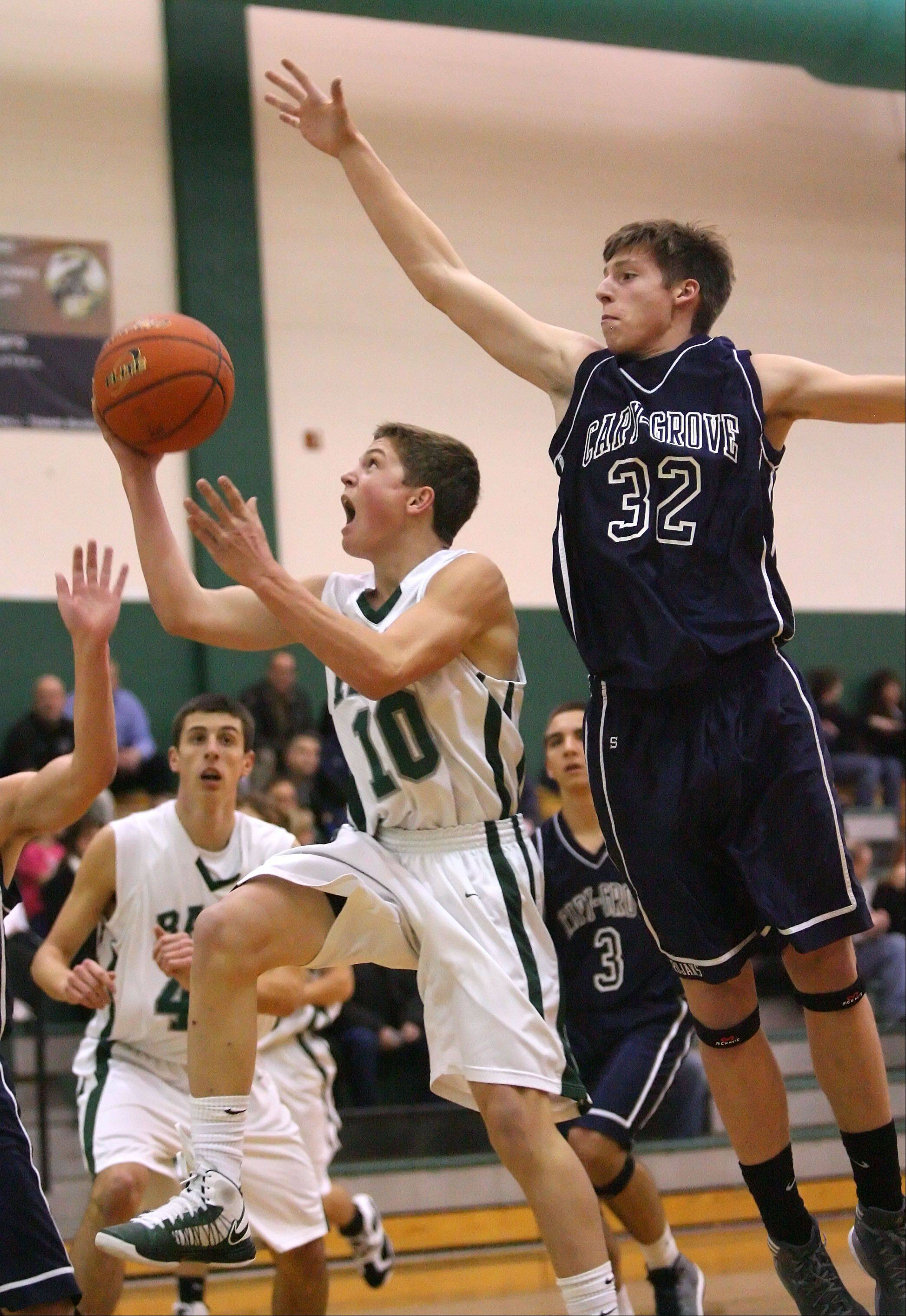 Grayslake Central's Joey Mudd, left, drives on Cary-Grove's Dean Lee.