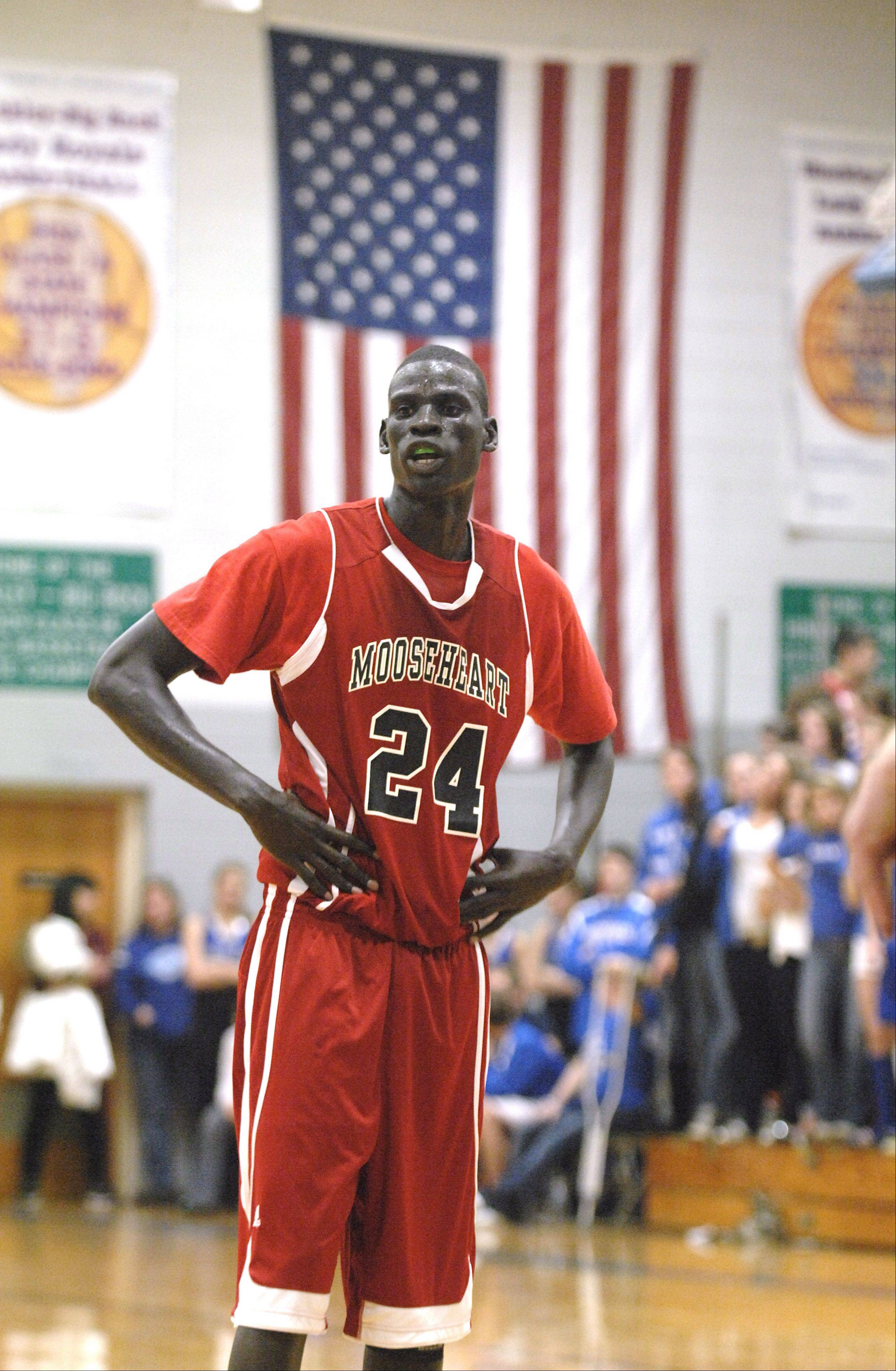 Mooseheart's Mangisto Deng waits for the ball at the free throw line in the second half against Hinckley-Big Rock. On Monday, Deng and his teammates found out good news from the IHSA.