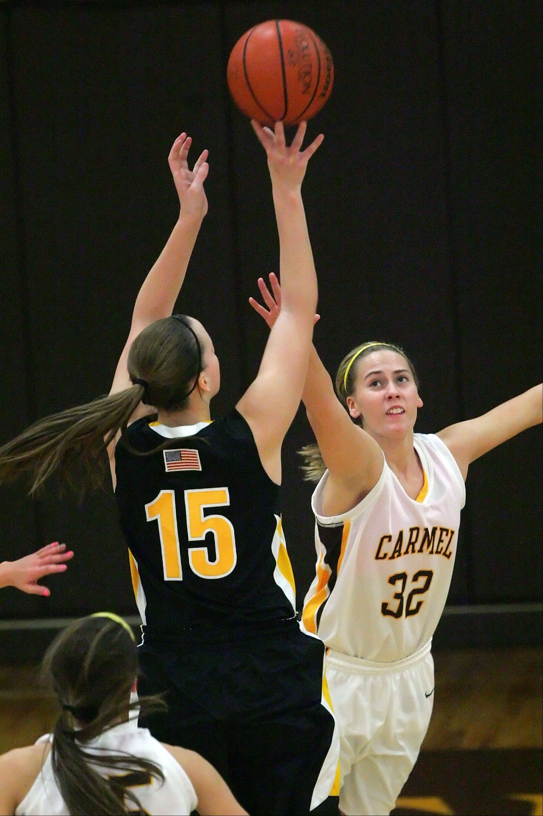 Carmel Catholic's Emma Rappe, right, defends against Marian Catholic's Megan Walsh.