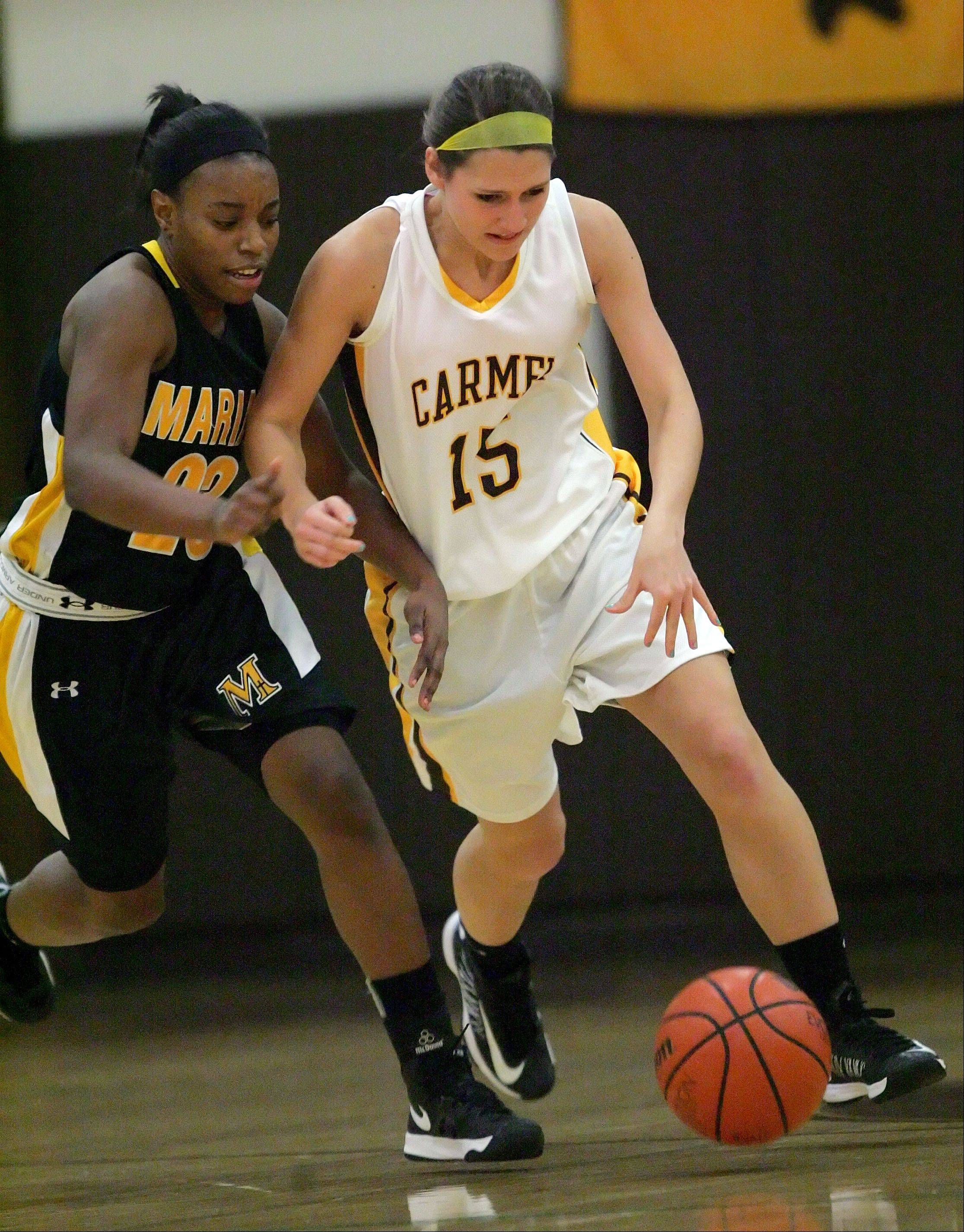 Carmel Catholic's Paige Gauthier, right, drives on Marian Catholic's Aliyah Isaac.