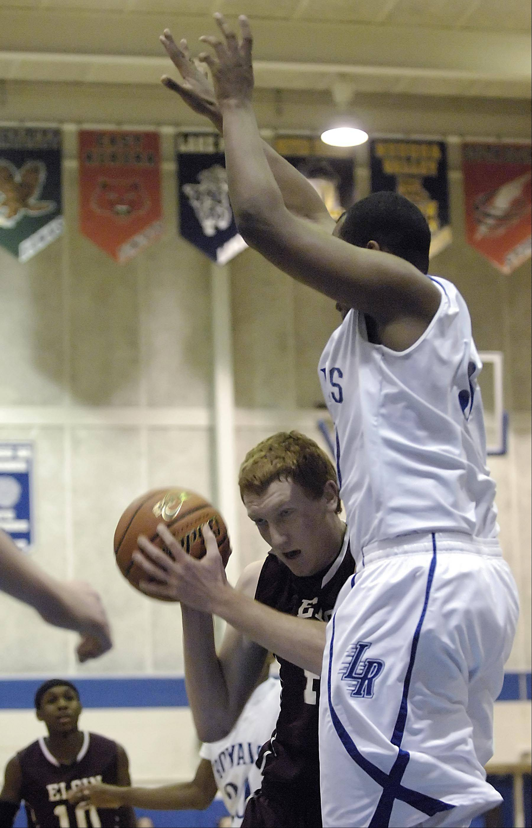 Elgin's Eric Sedlack is fouled by Larkin's Daniel McFadden Wednesday at Larkin High School in Elgin.