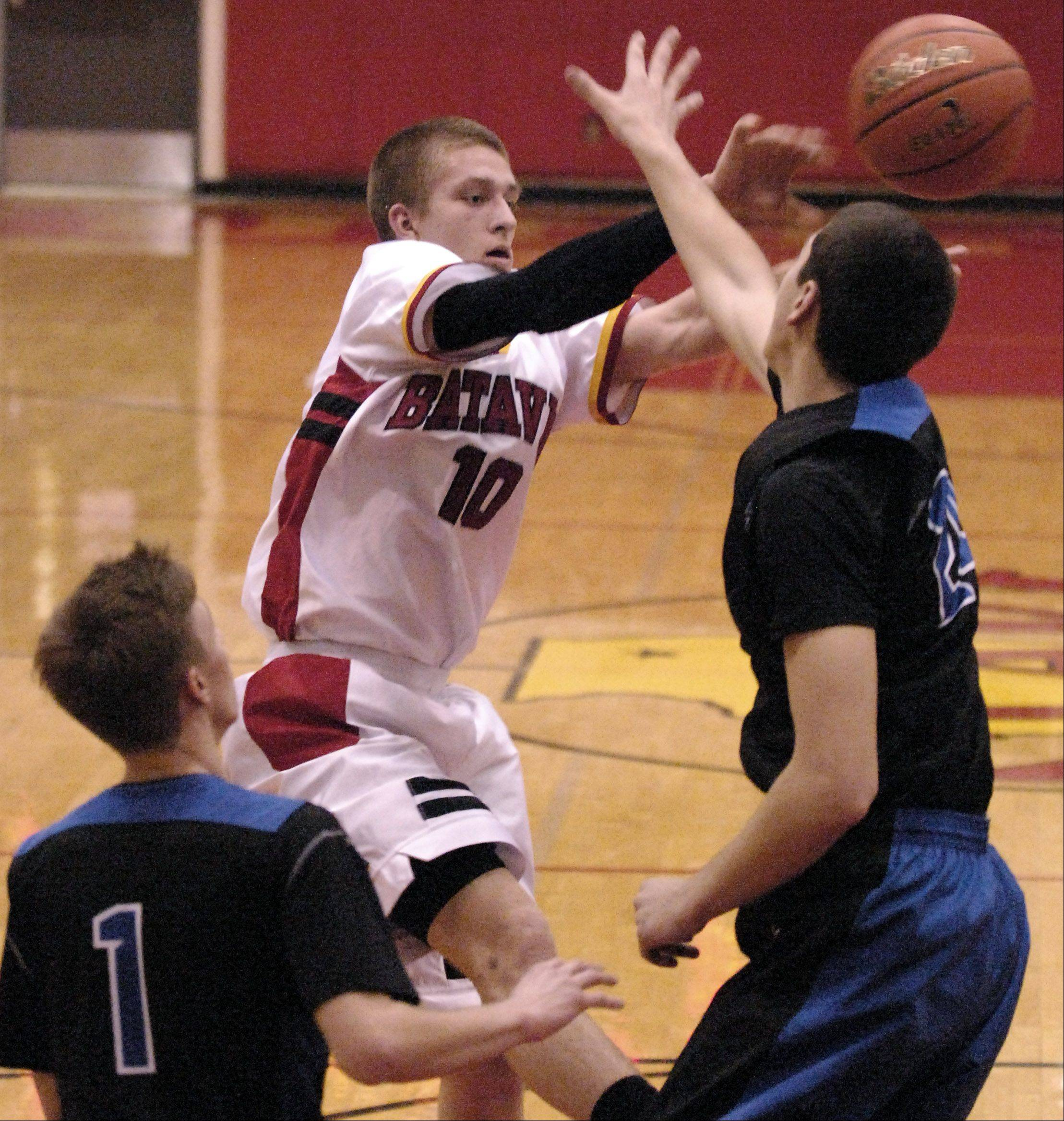 Batavia's Mike Rueffer passes out of the double team against St. Charles North during Thursday's game at Batavia.