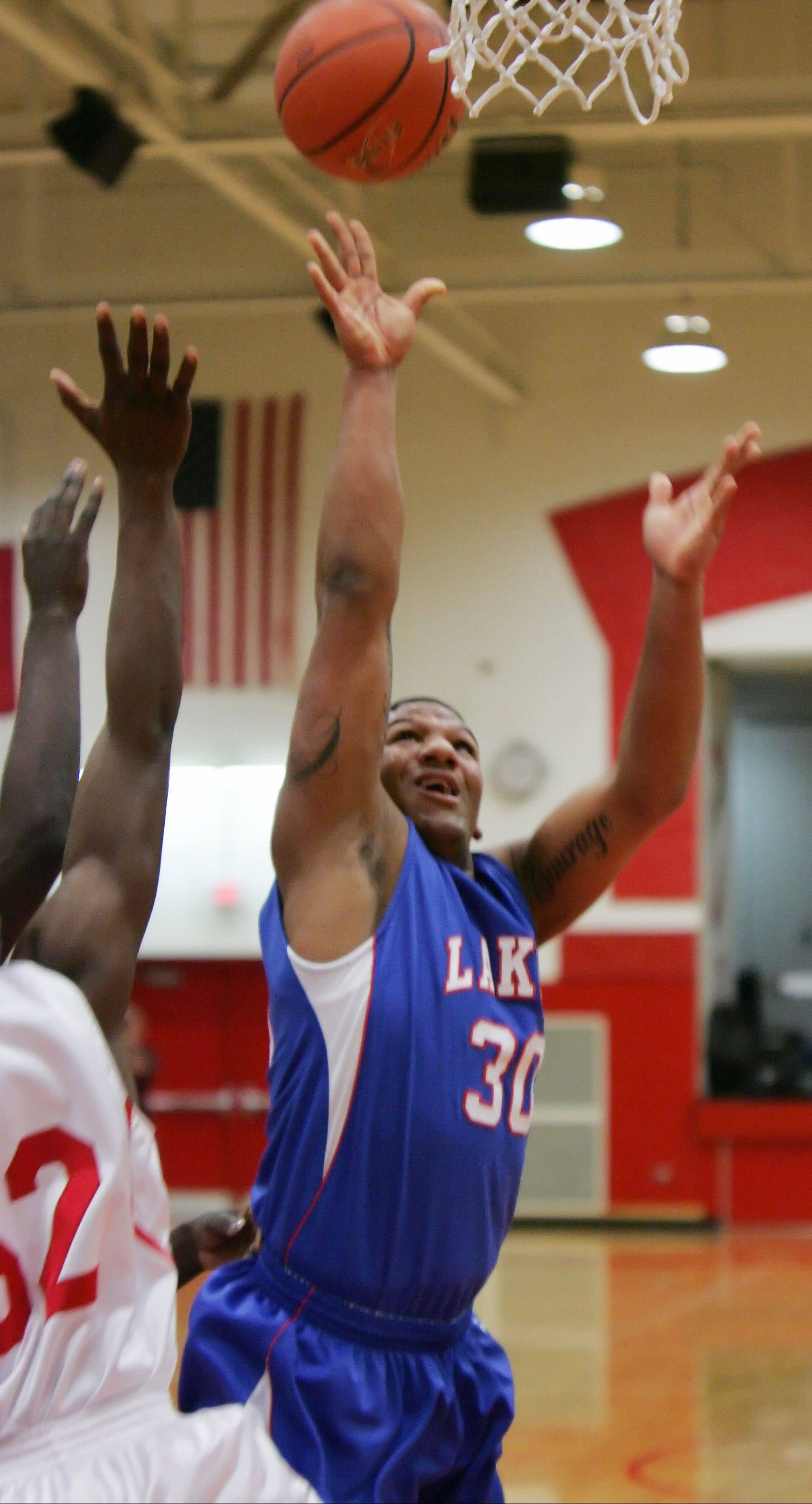 Lakes forward Direll Clark goes up for a shot Thursday at North Chicago.