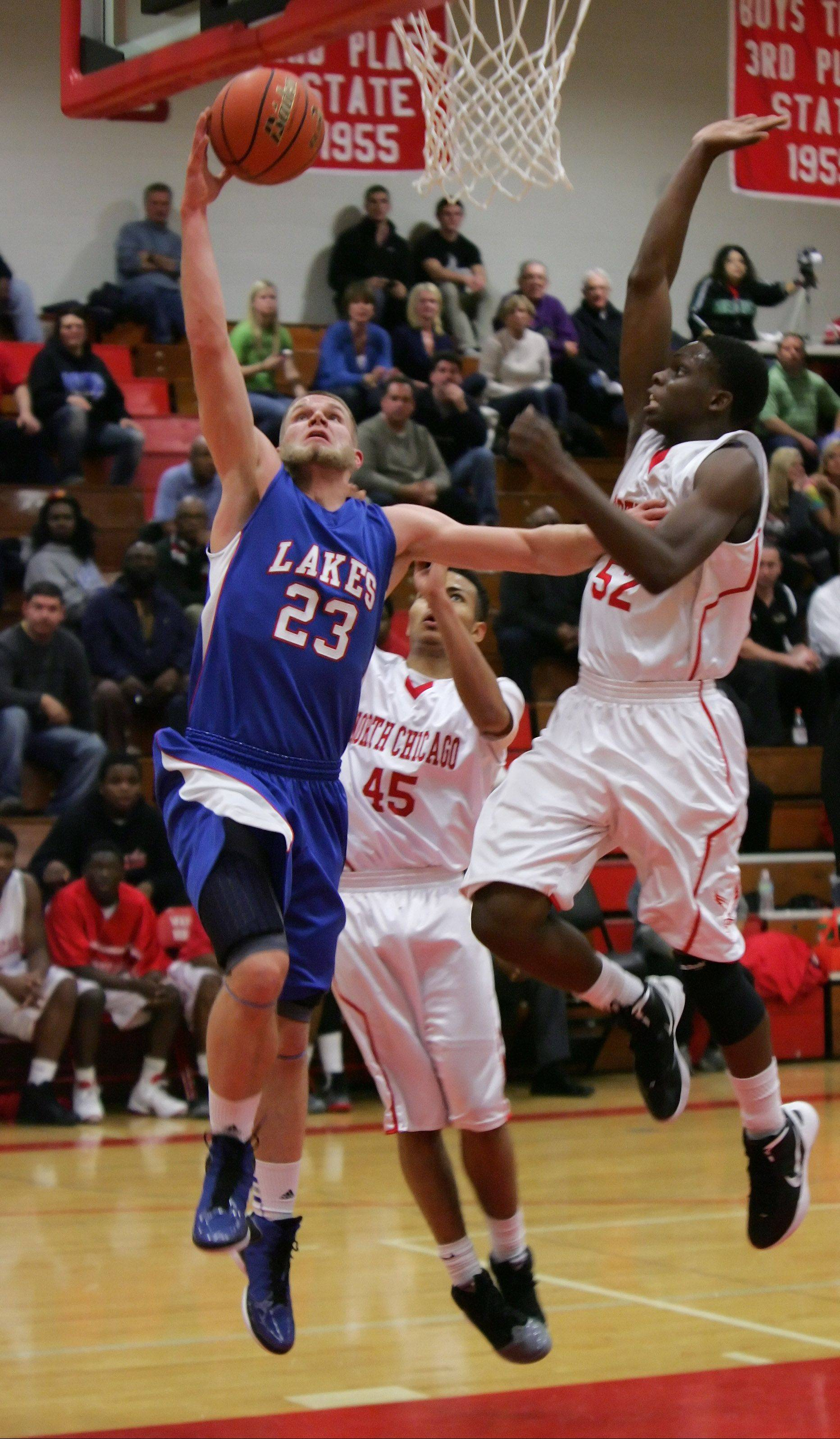 Lakes Jake Kohler goes up for a layup against North Chicago's Jarrod Coleman Thursday at North Chicago.