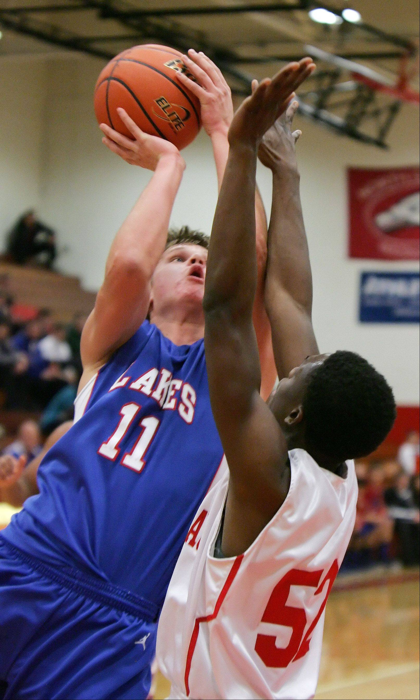 Lakes' Justin Bergeron goes up for a shot over North Chicago forward Jarrod Coleman Thursday at North Chicago.