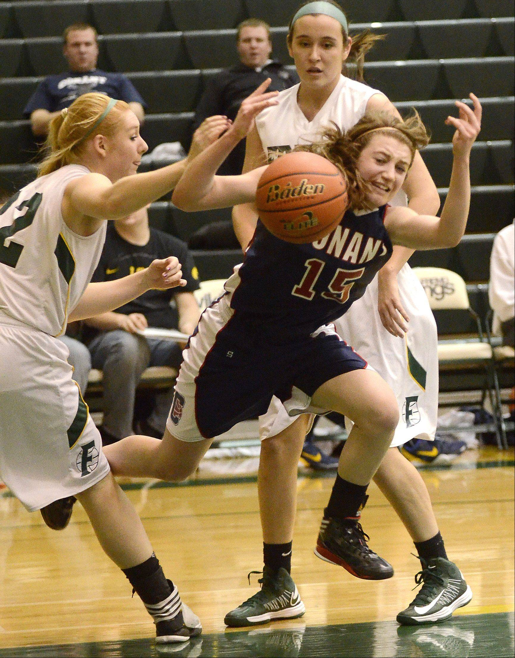Fremd's Sydney Sek fouls Conant's Lexi Zades (15) during Thursday night's MSL West game in Palatine.