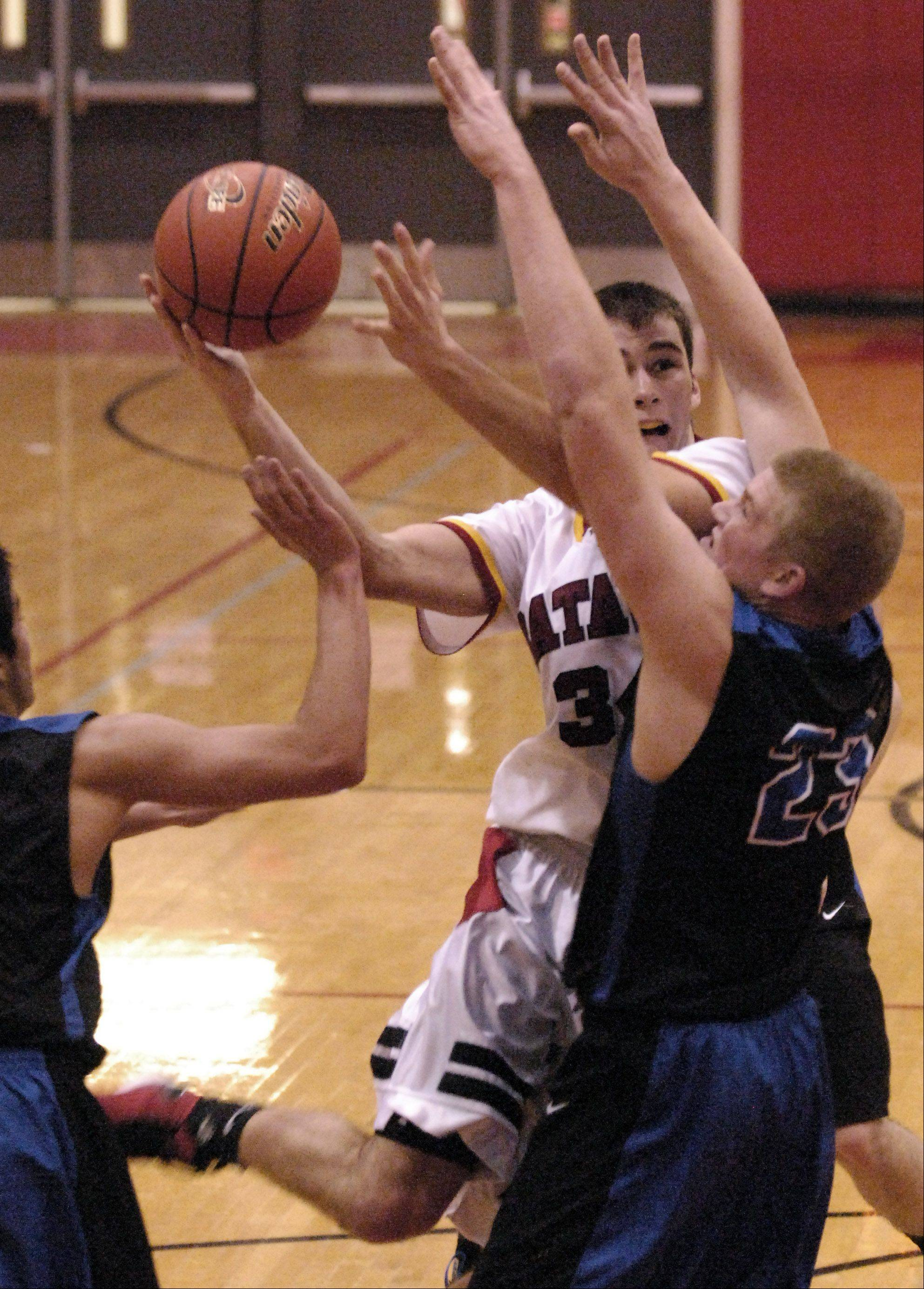 Batavia's Zach Strittmatter drives against St. Charles North's Justin Stanko.