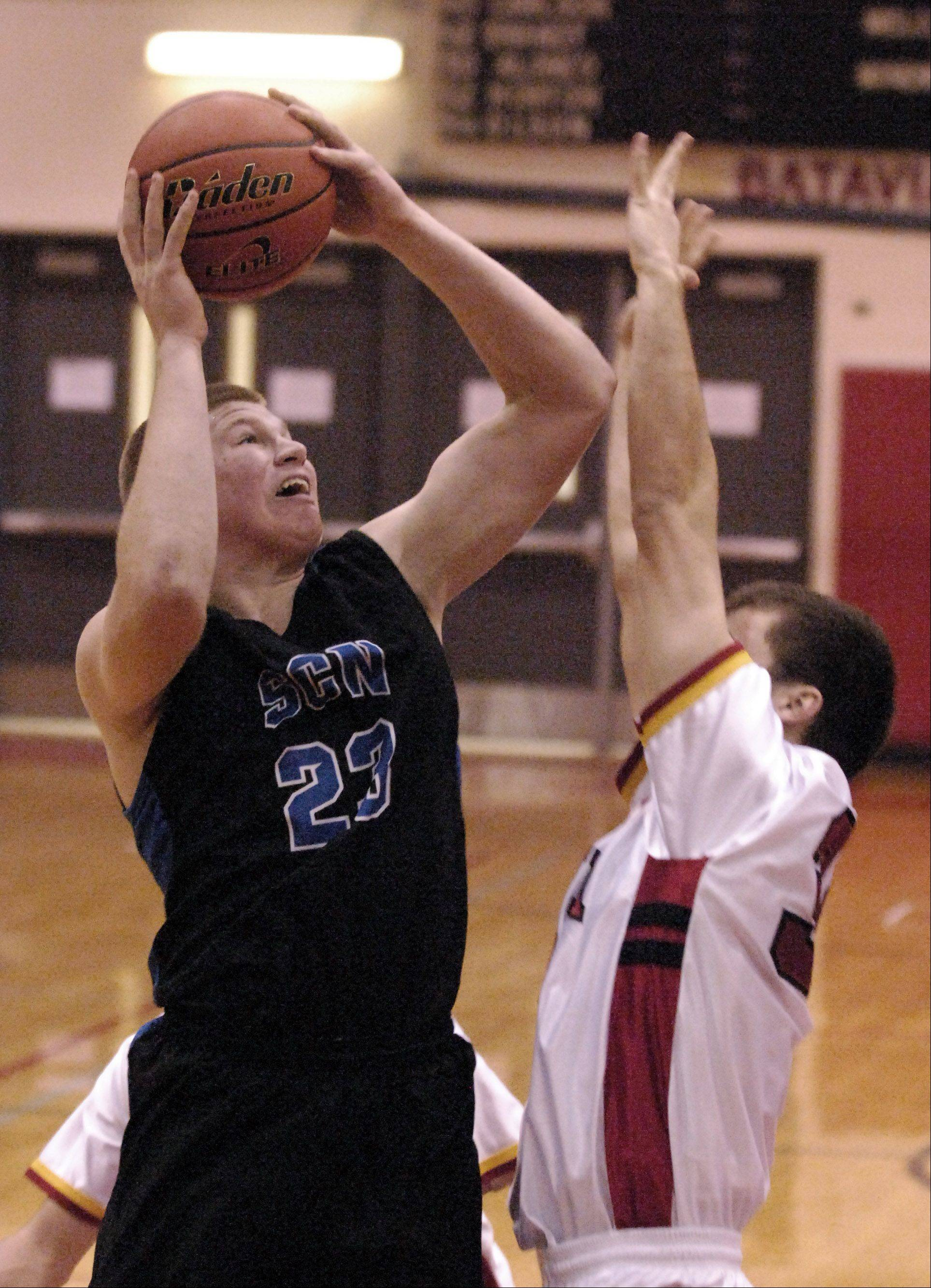 St. Charles North's Justin Stanko goes up and scores against Batavia.