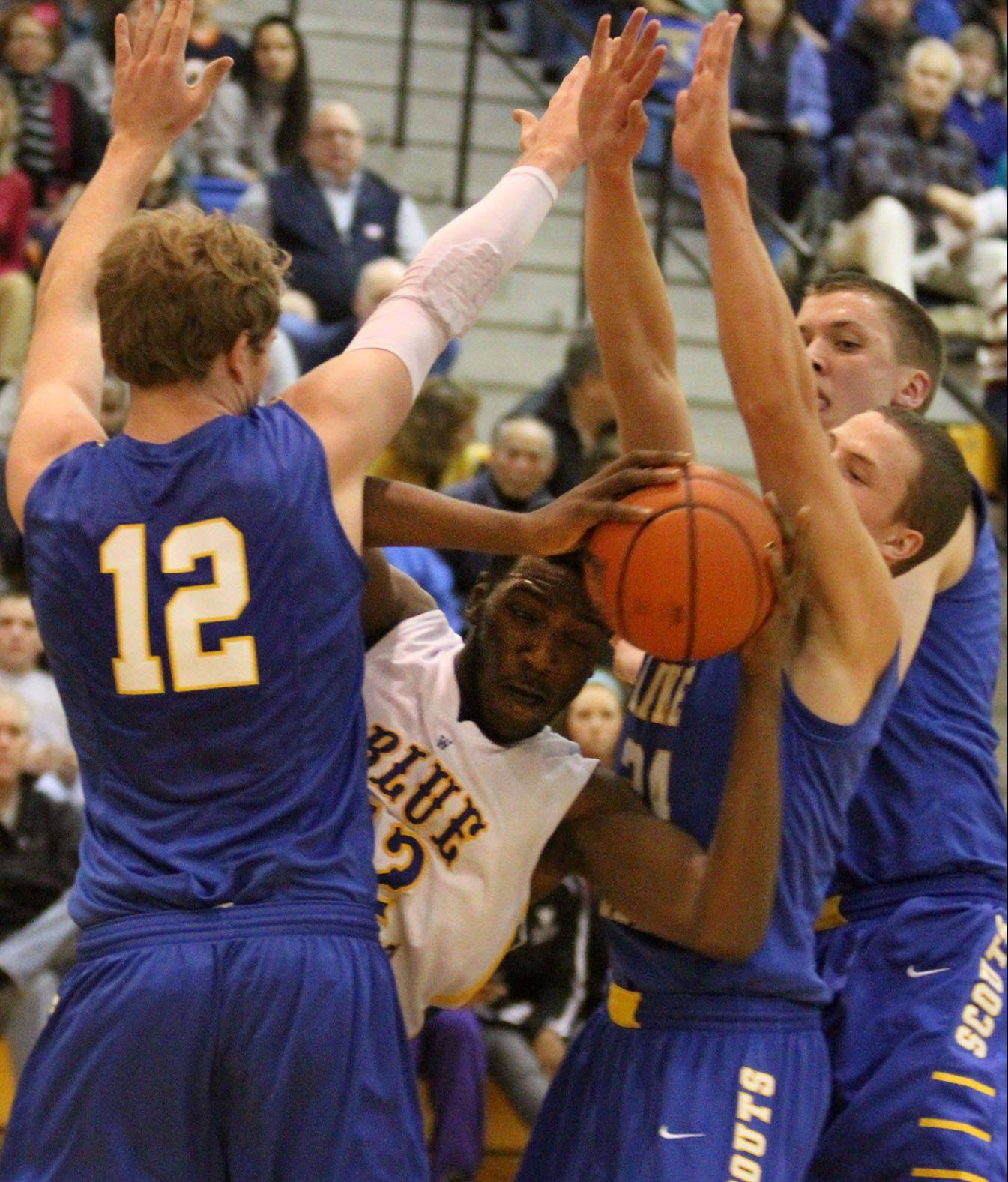 Warren's Dre' Von Hill is boxed in by three Lake Forest defenders, including Evan Boudreaux, left, in Gurnee on Friday.