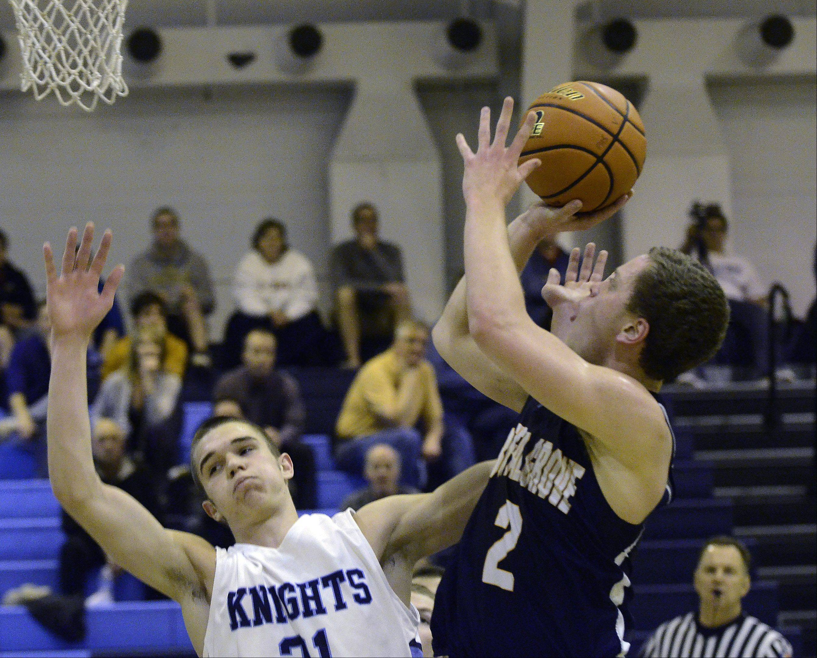 Prospect's Jake Young (31) goes down as Buffalo Grove's Luke Potnick makes a shot Friday night at Prospect.