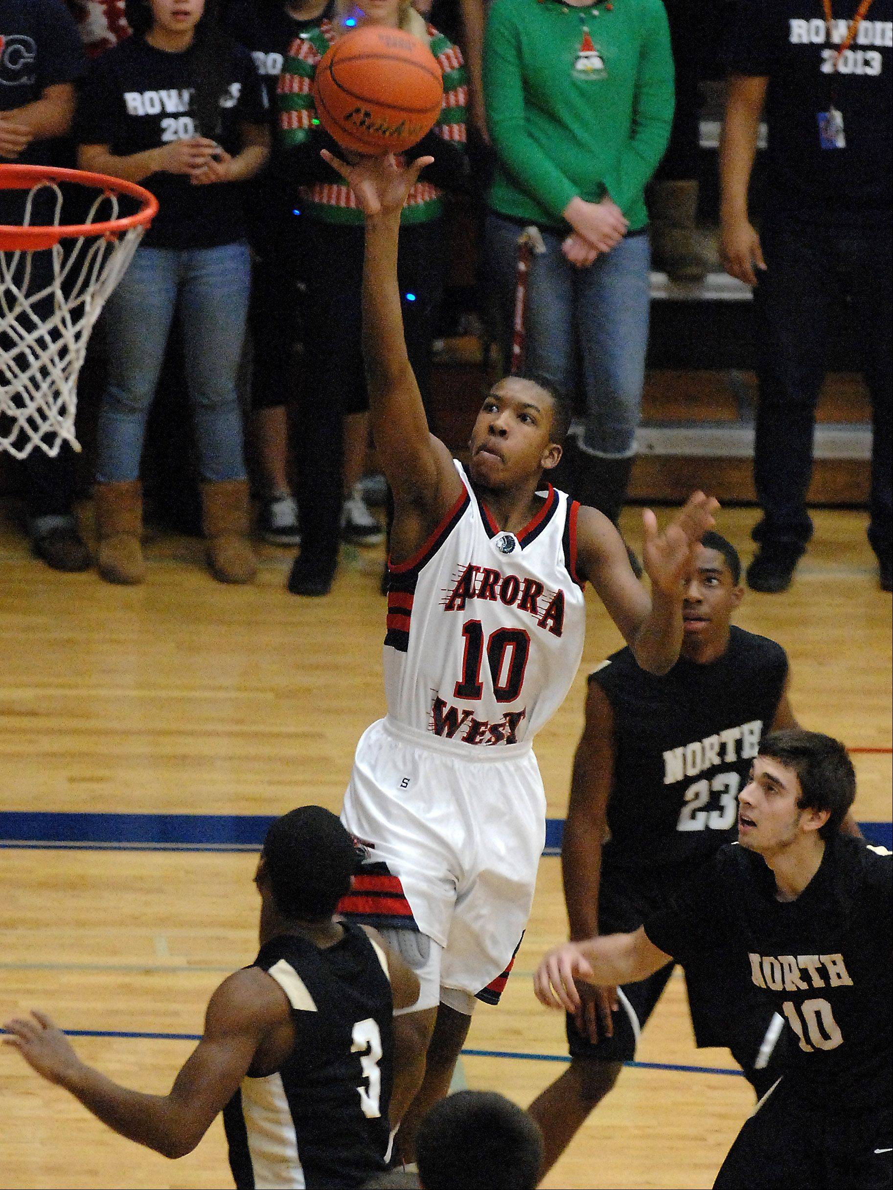 West Aurora's Jontrel Walker scores on a running one-hander against Glenbard North during Friday's game at West Aurora.