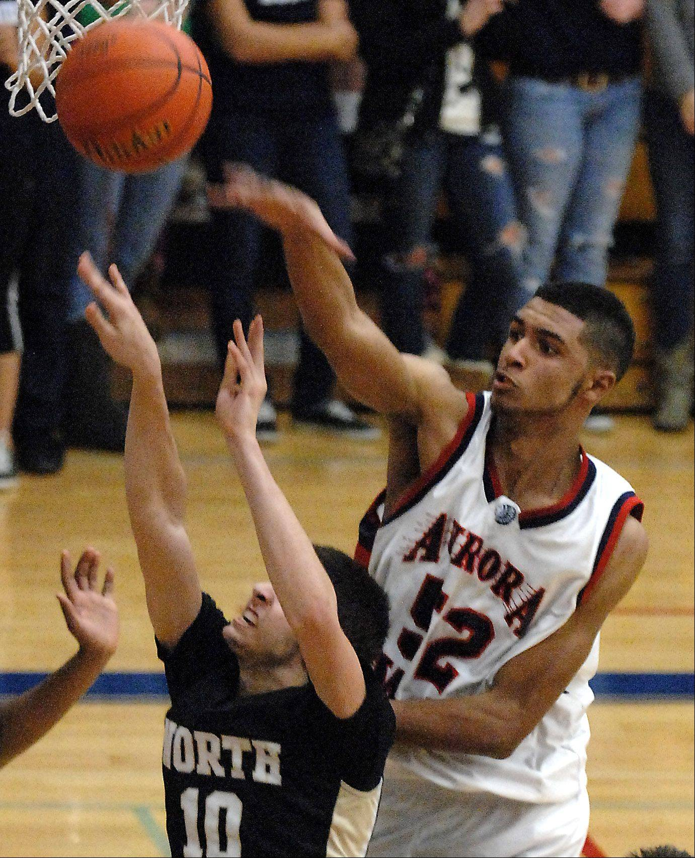 West Aurora's Joshua McAuley blocks a shot by Glenbard North's Pasquale Fiduccia.