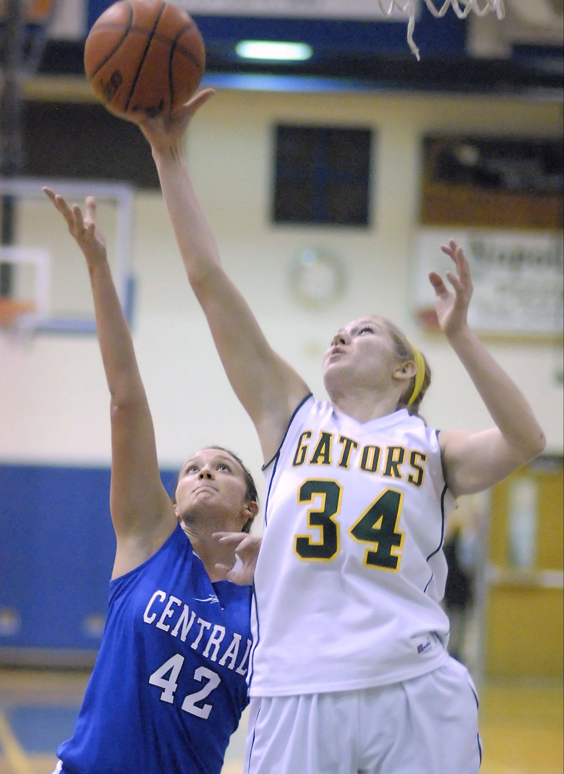 Burlington Central's Alison Colby and Crystal Lake South's Sara Mickow battle for a rebound Saturday during the Northern Illinois Holiday Classic at Woodstock.