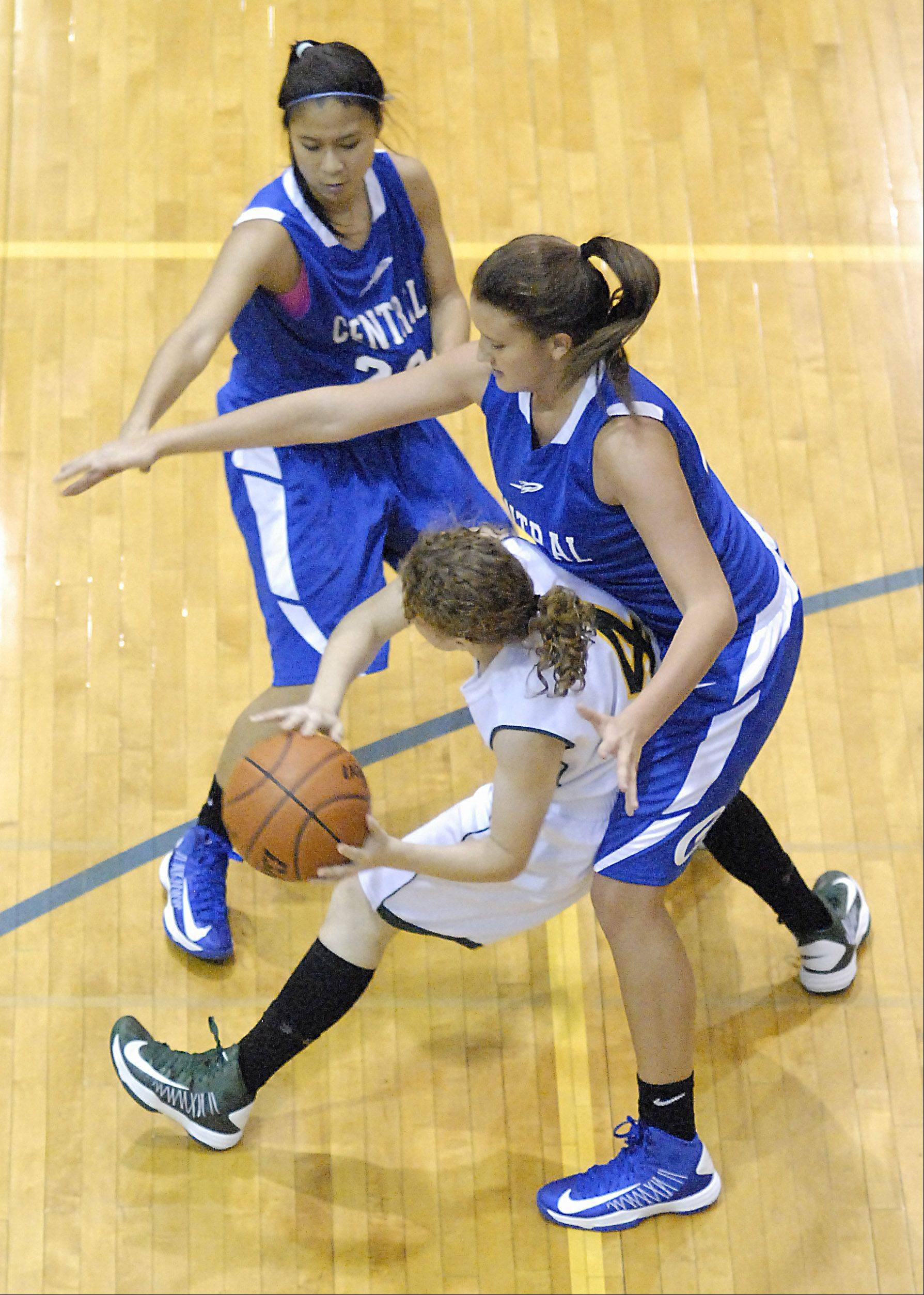 Burlington Central's Camille Dela Cruz and Alison Colby swarm Crystal Lake South's Carina Madoni Saturday in Woodstock.
