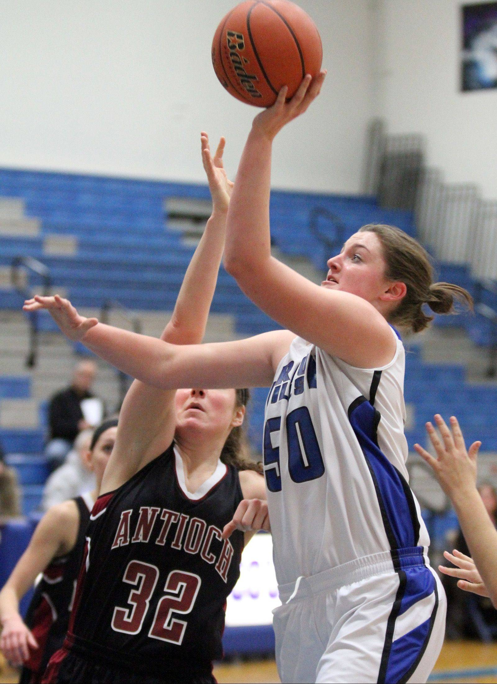 Vernon Hills' Meri Bennett-Swanson shoot over Antioch defender Alexandra Fracek on Saturday at Vernon Hills.