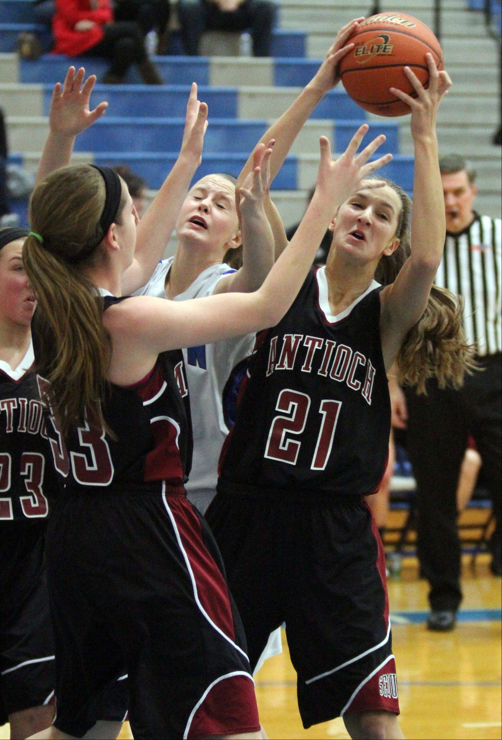 Antioch's Carly McCameron pulls in a rebound against Vernon Hills on Saturday at VH.