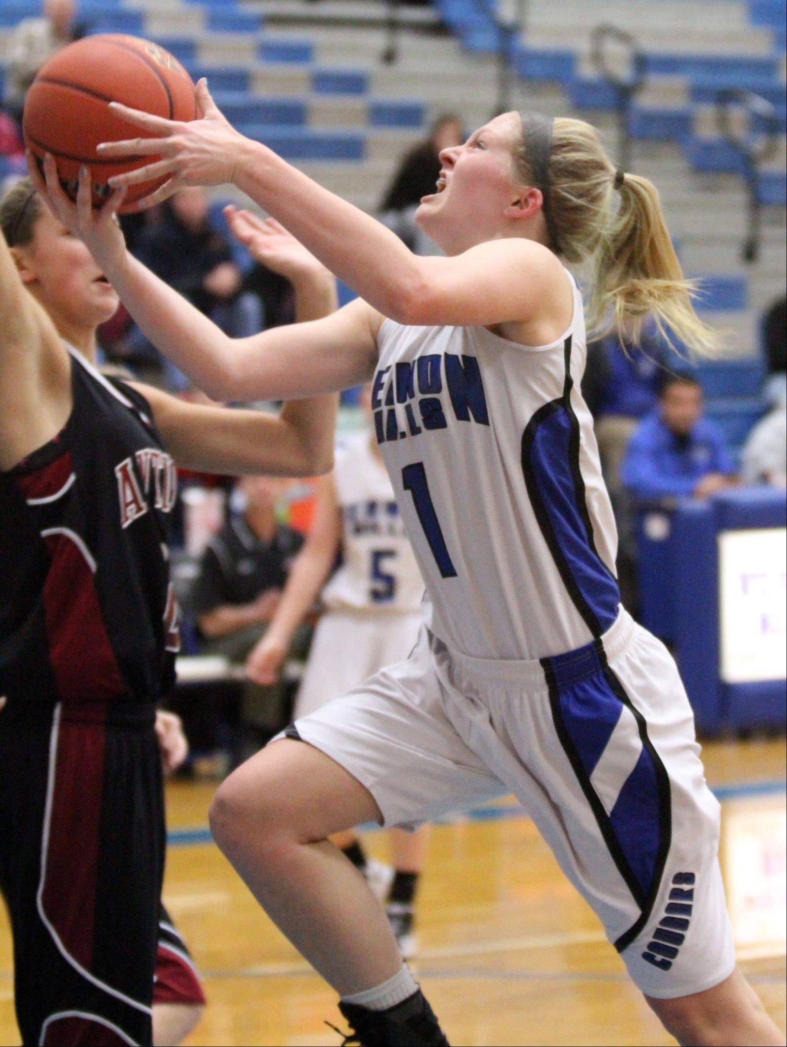 Vernon Hills' Sydney Smith drives in for a layup against Antioch in Vernon Hills on Saturday, December 15.