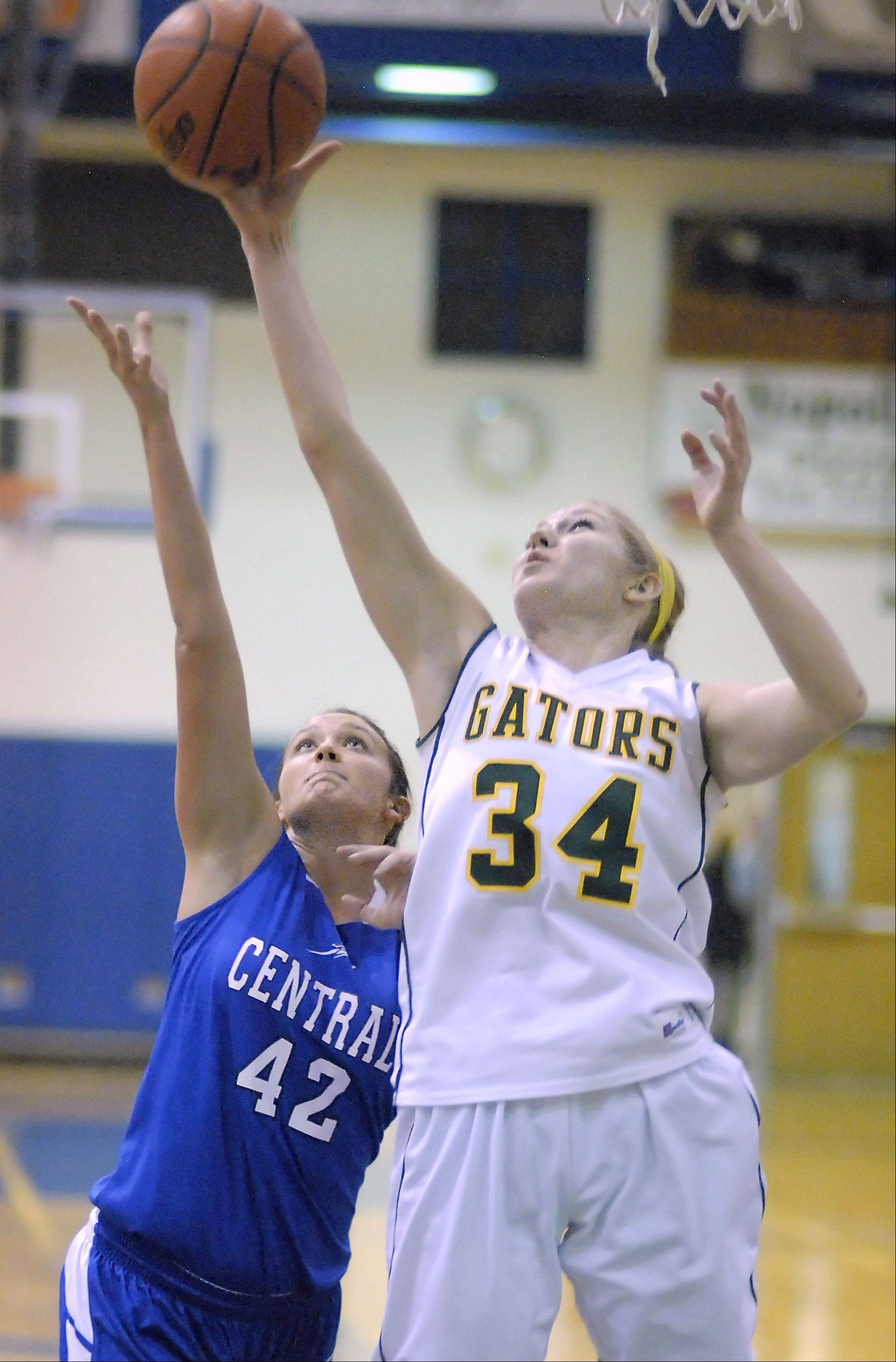 Burlington Central's Alison Colby and Crystal Lake South's Sara Mickow both leap for a rebound in the first quarter on Saturday, December 15.