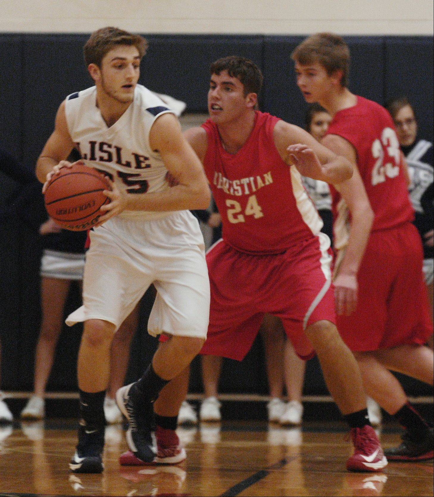 Matt Bucher of Lisle looks to move around Ryan McQuade of Aurora Christian High School Monday night during boys basketball.
