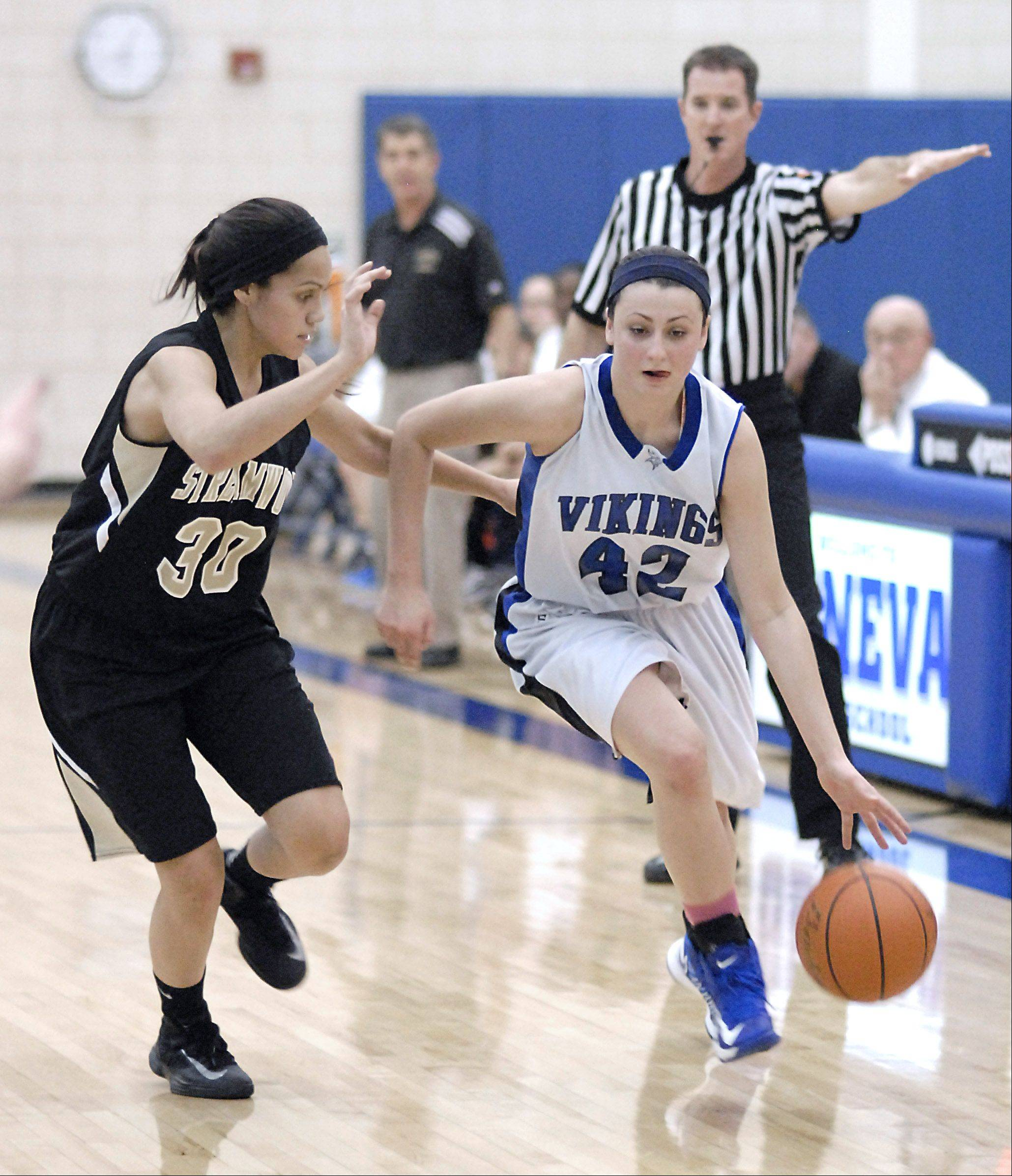 Streamwood senior Jessica Cerda, left, covers Geneva's Abby Novak last week in Geneva. Cerda goes into the Sabres' game Wednesday night at Bartlett 17 points shy of 1,000 for her career.