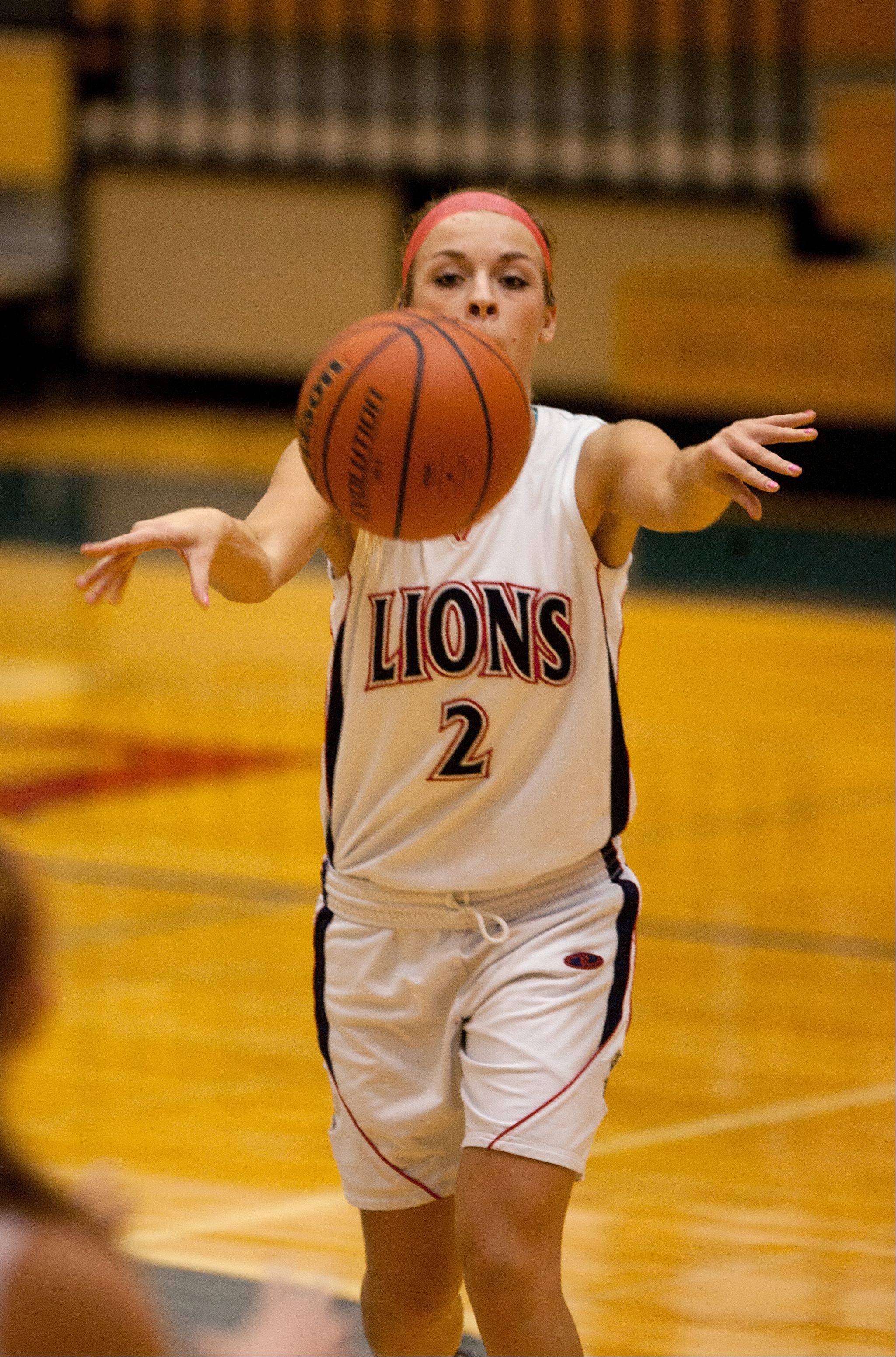 Lisle's Skyler Tomko passes in the paint against Timothy Christian.
