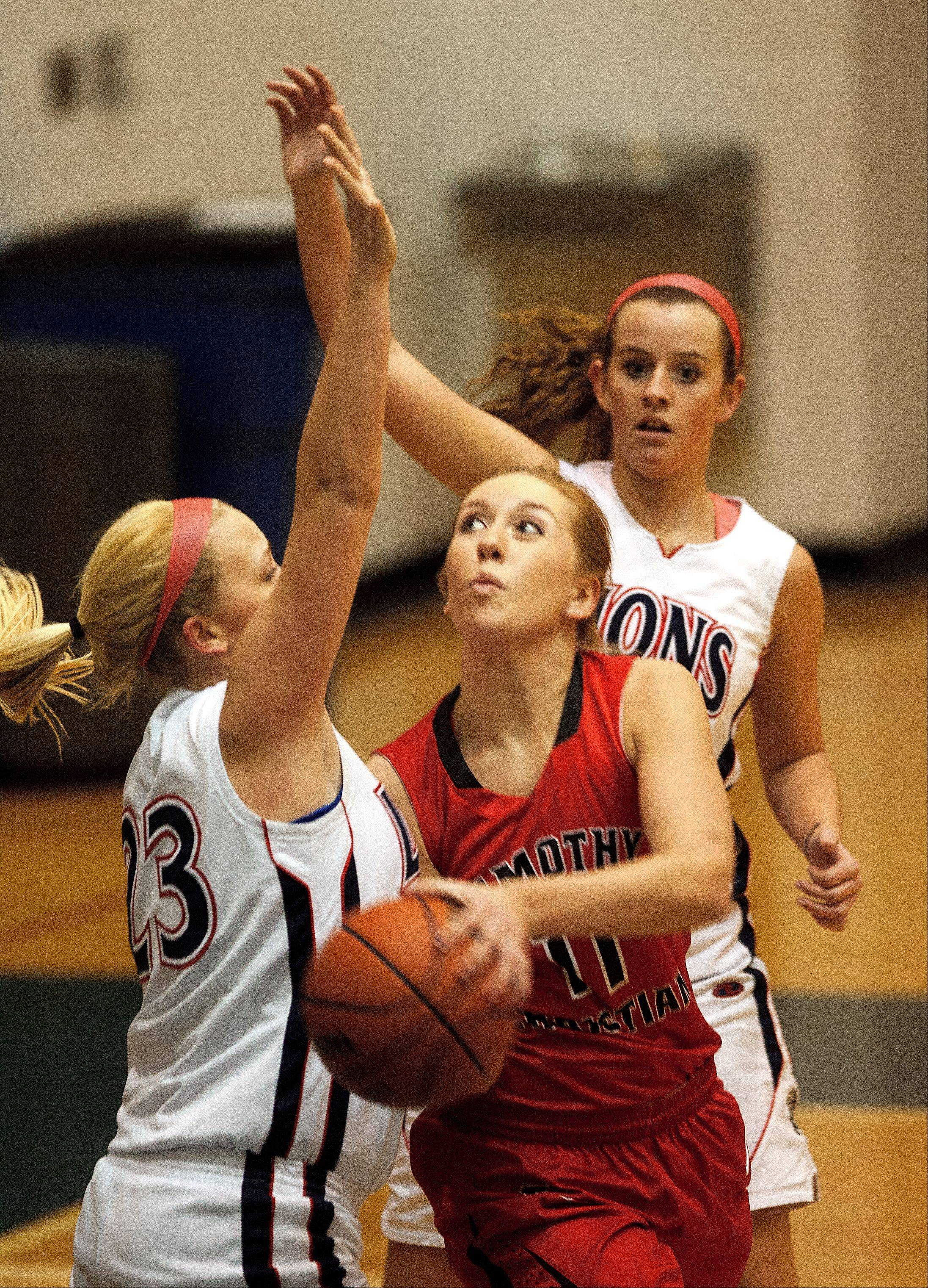 Lisle's Sierra Birdsell, left, defends Timothy Christian's Stephanie Kuiper, right.