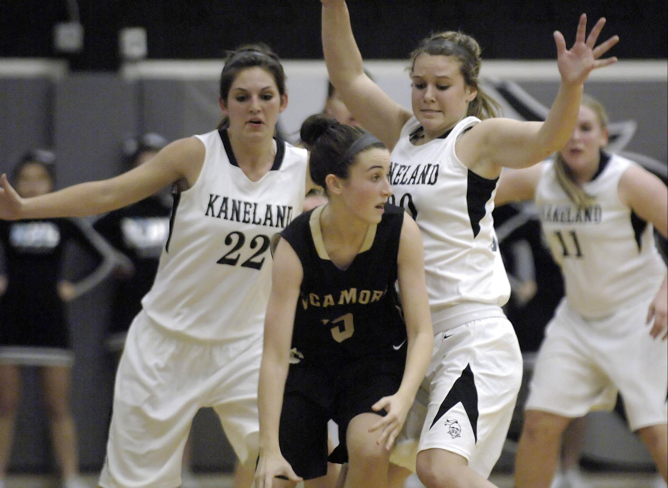 Kaneland's Brooke Harner (22) applies defensive pressure.