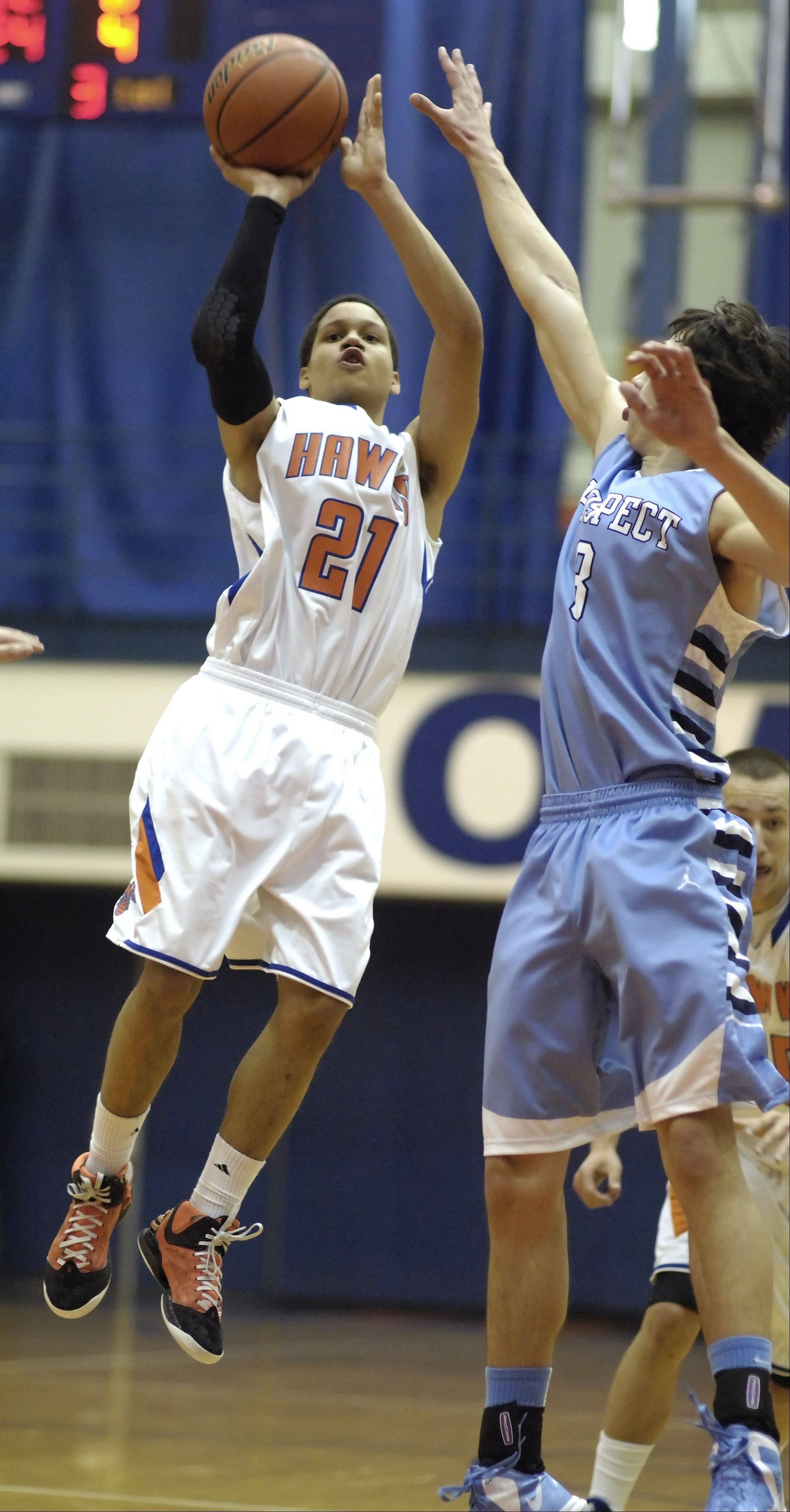 Hoffman Estates' Iziah Robinson takes a shot against Prospect's Bobby Frasco.