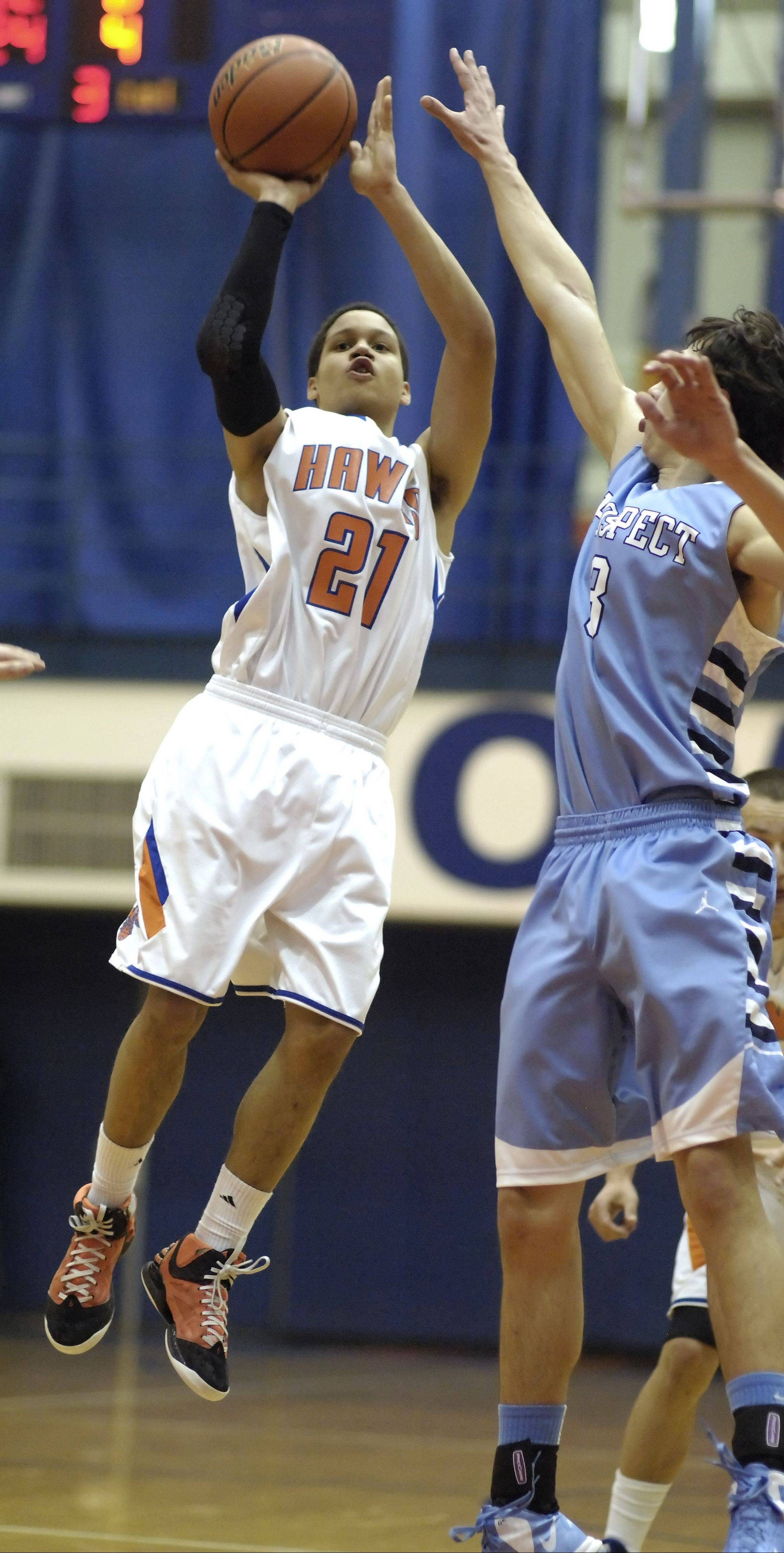 Hoffman Estates' Iziah Robinson takes a shot against the defense of Prospect's Bobby Frasco during Tuesday's game.