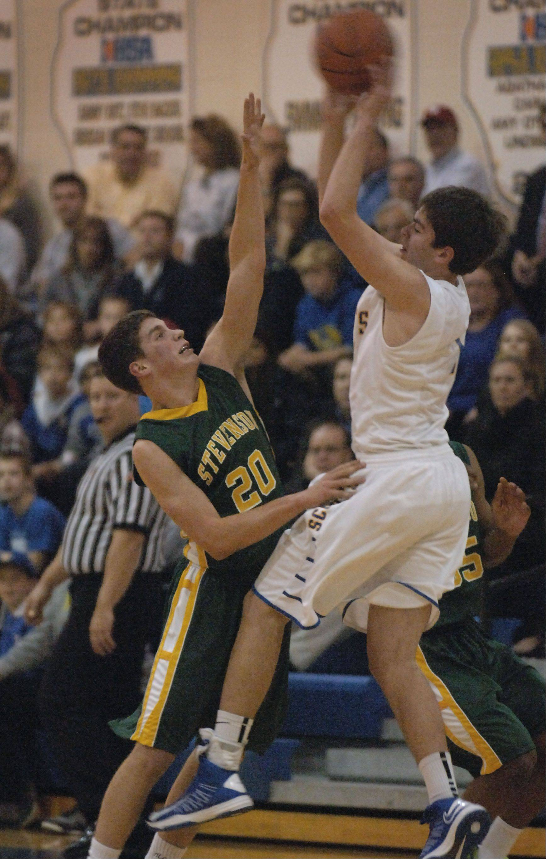 Paul Valade/pvalade@dailyherald.com Stevenson's Matthew Morrissey, 20, puts the pressure on Lake Forest's Ben Simpson Tuesday night in Lake Forest.