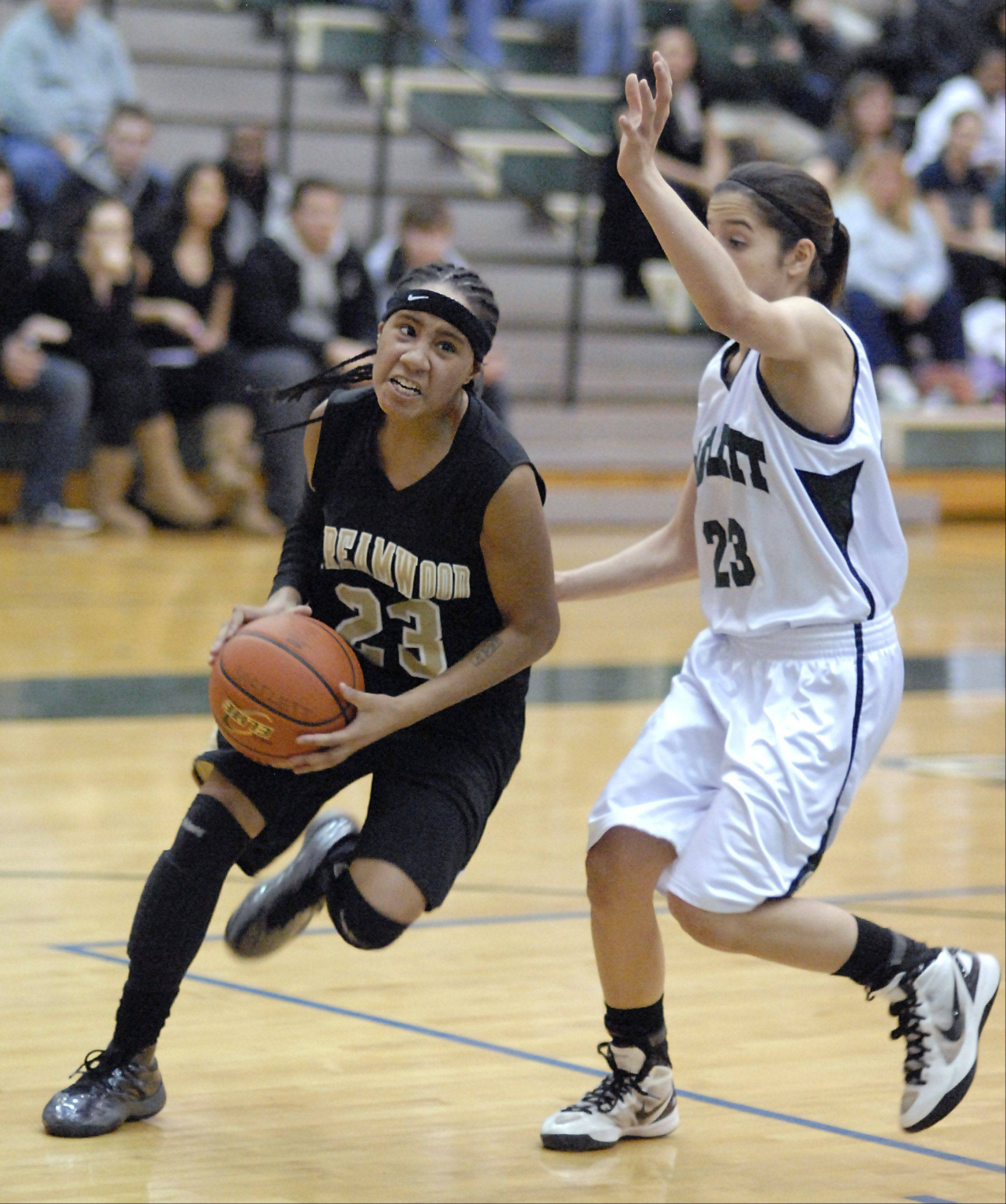 Streamwood's Deja Moore approaches the basket with Bartlett's Ally Giampapa defending in the fourth quarter on Wednesday at Bartlett.