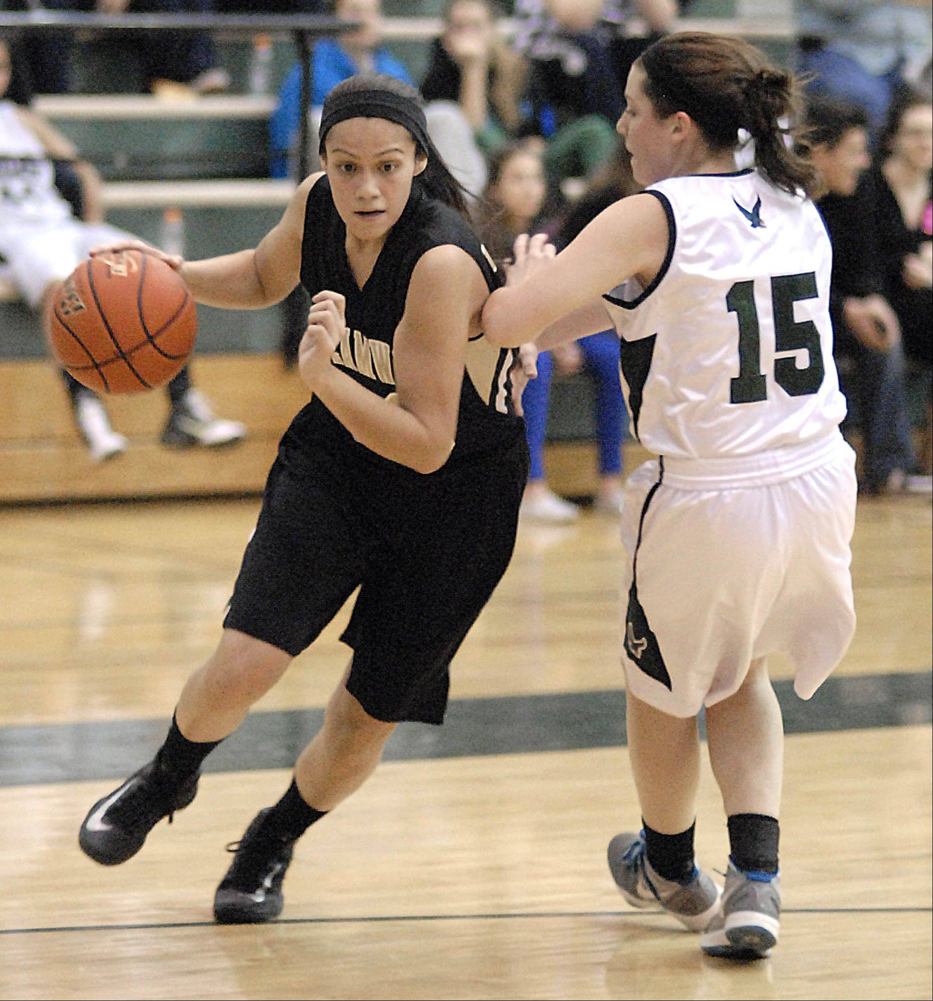 Streamwood's Jessica Cerda maneuvers around Bartlett's Elizabeth Arco Wednesday at Bartlett.
