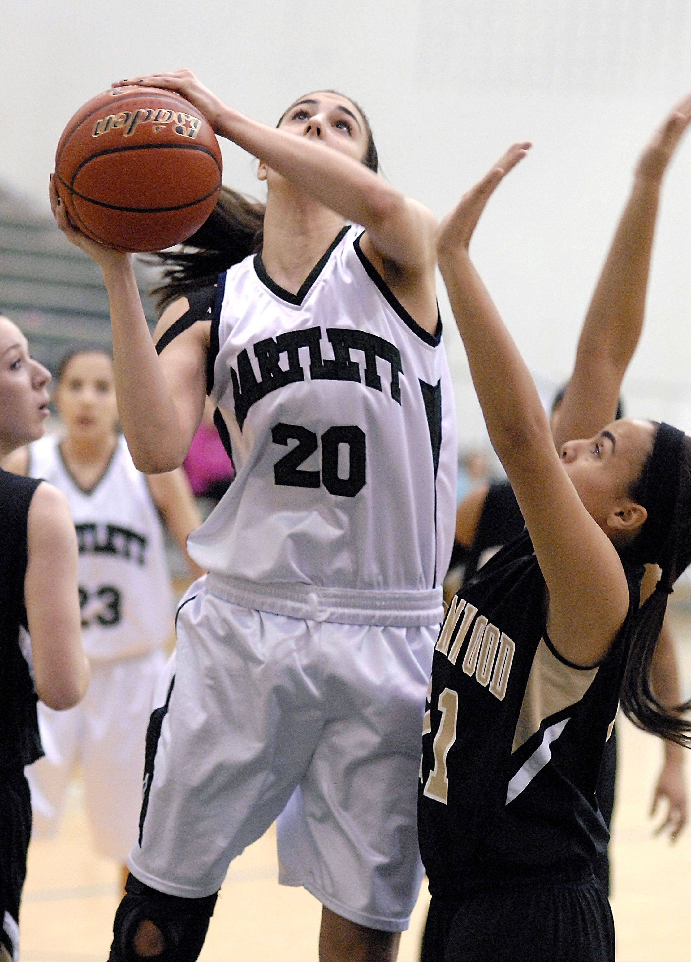 Streamwood's Brittany Delao attempts to block a shot by Bartlett's Elizabeth Arco in the first quarter on Wednesday at Bartlett.