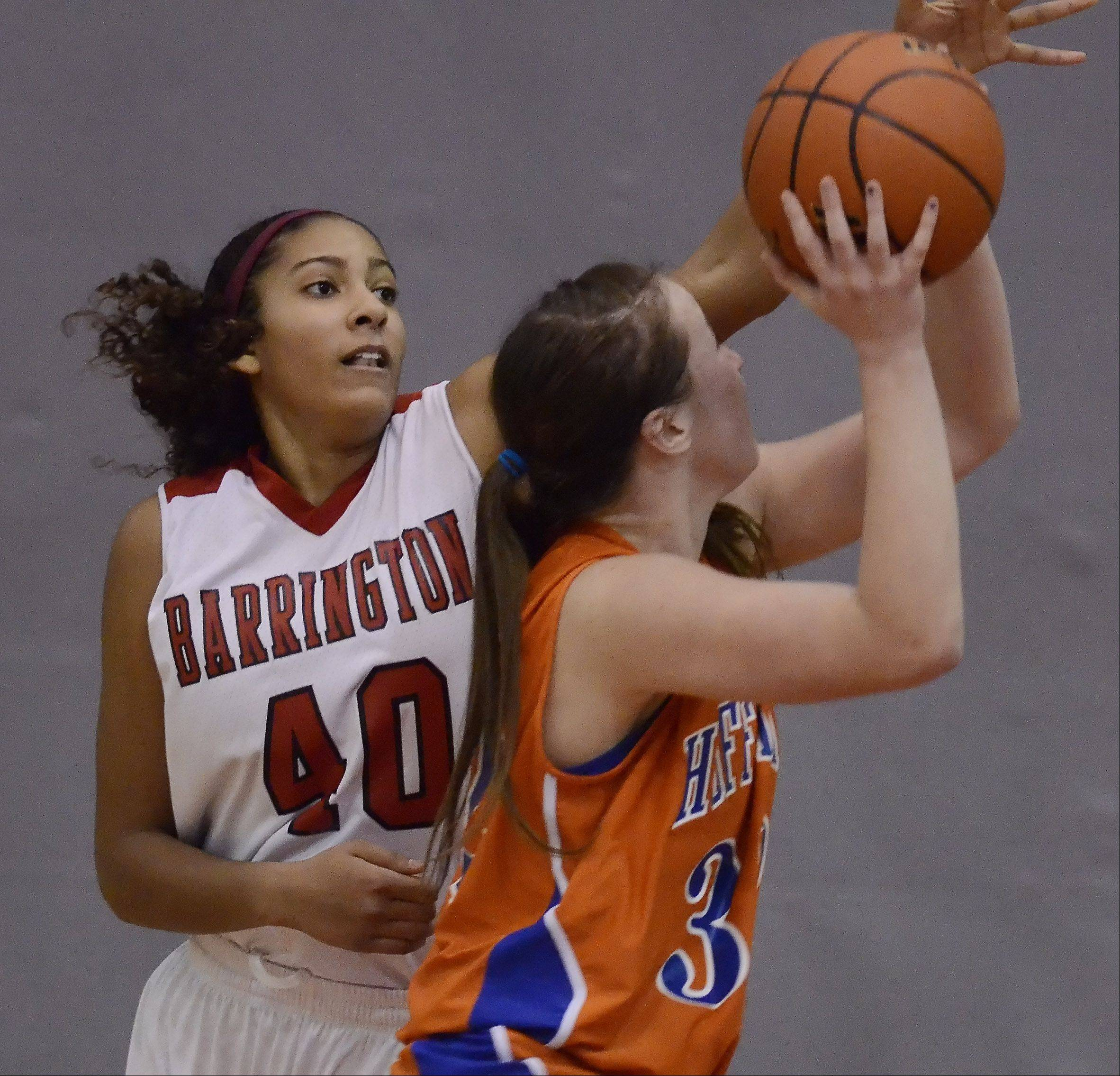 Barrington's Bryana Hopkins, left, blocks the shot of Hoffman Estates' Becca Stoczynski during Wednesday's game.