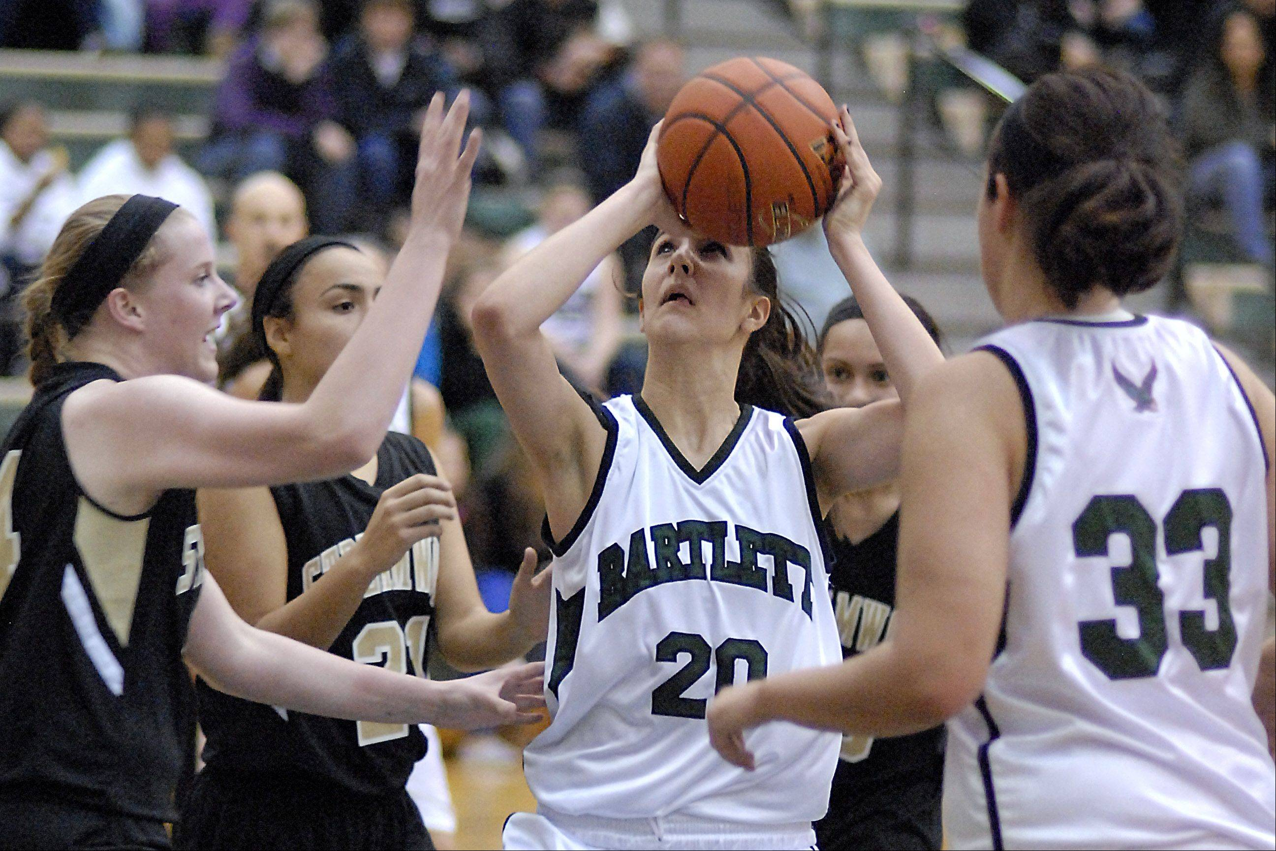 Streamwood's Hannah McGlone attempts to block a shot by Bartlett's Elizabeth Arco in the second quarter.