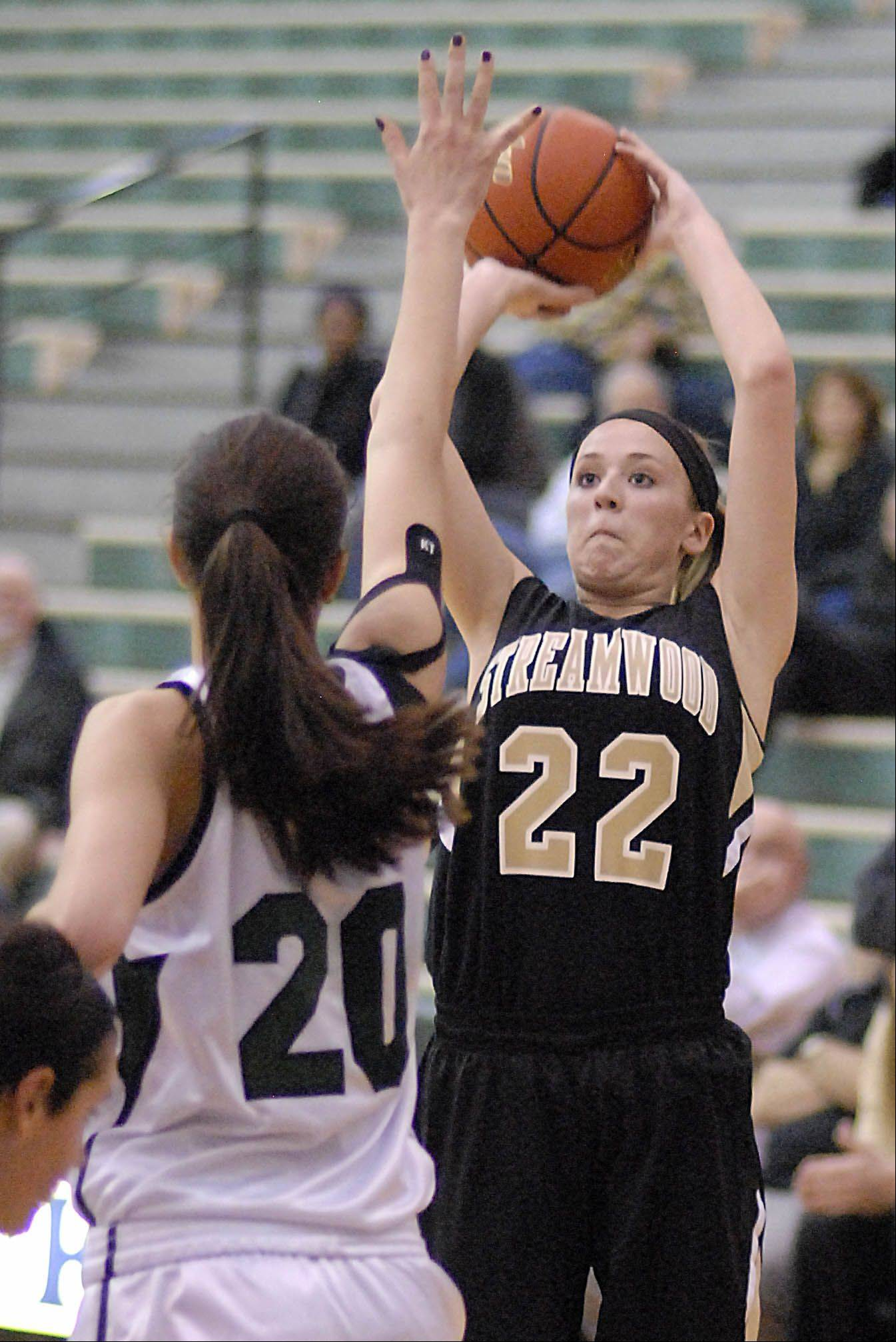 Streamwood's Holly Foret shoots over a block by Bartlett's Elizabeth Arco in the third quarter.