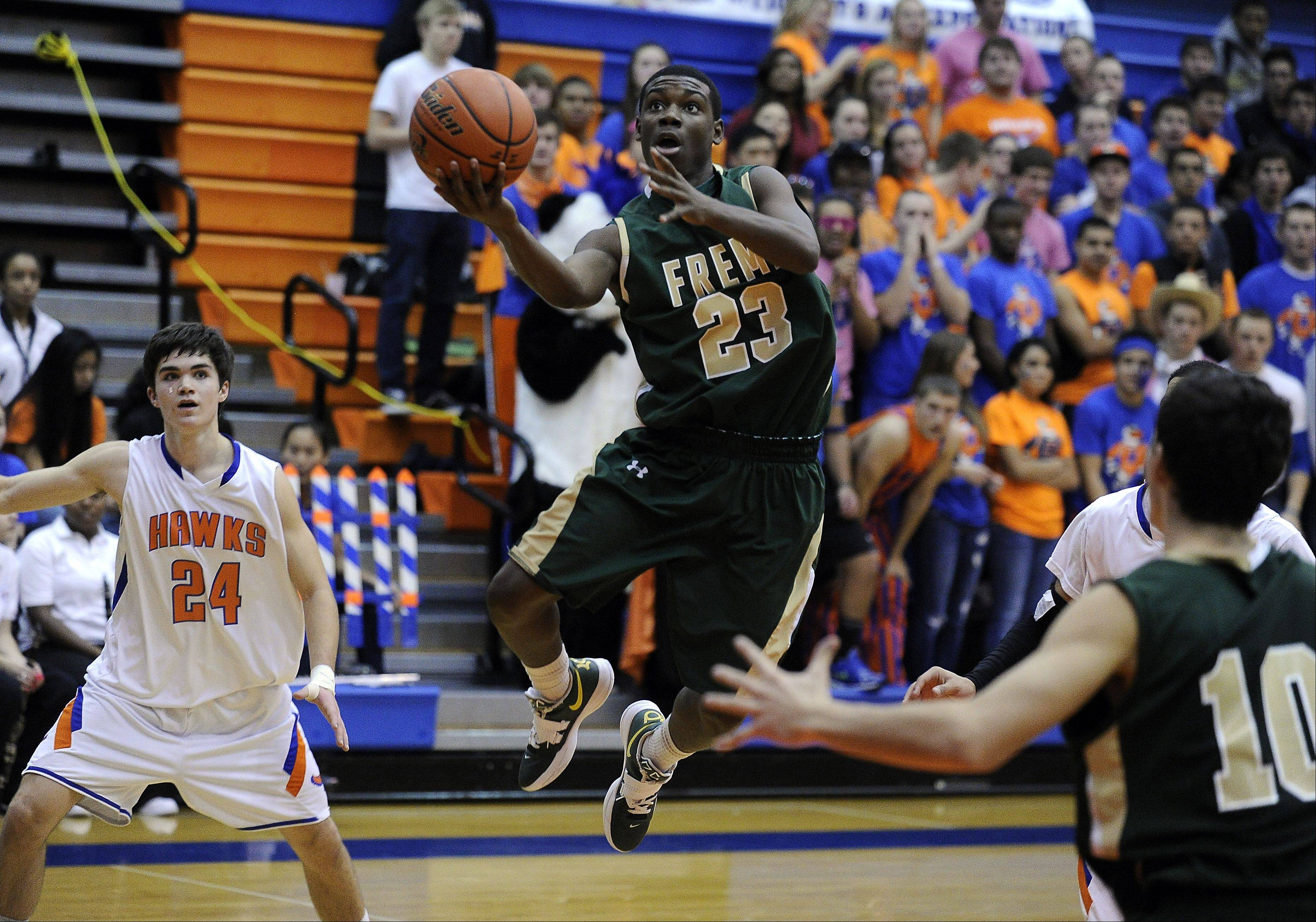 Fremd's Jalon Roundy glides through Hoffman's defense and goes airborne for the bucket against Hoffman Estates.