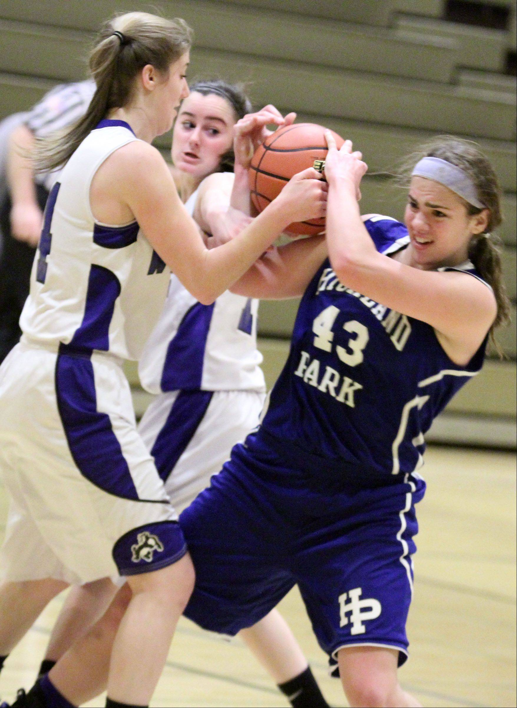 Wheeling's Hannah Dobrowski and Highland Park's Lena Munzer struggle for possession of the ball at Wheeling on Thursday.