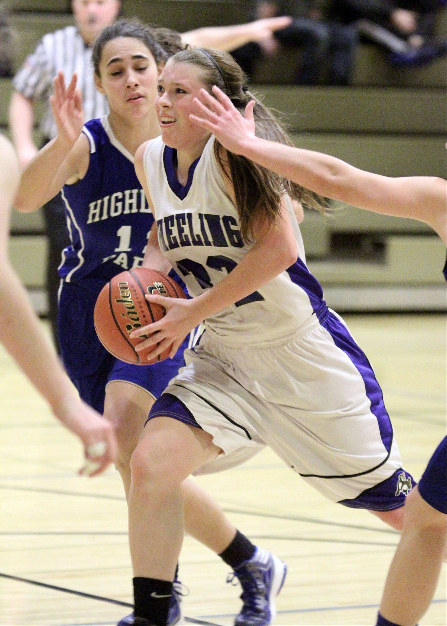 Wheeling's Brie Majkowski drives the lane against Highland Park.