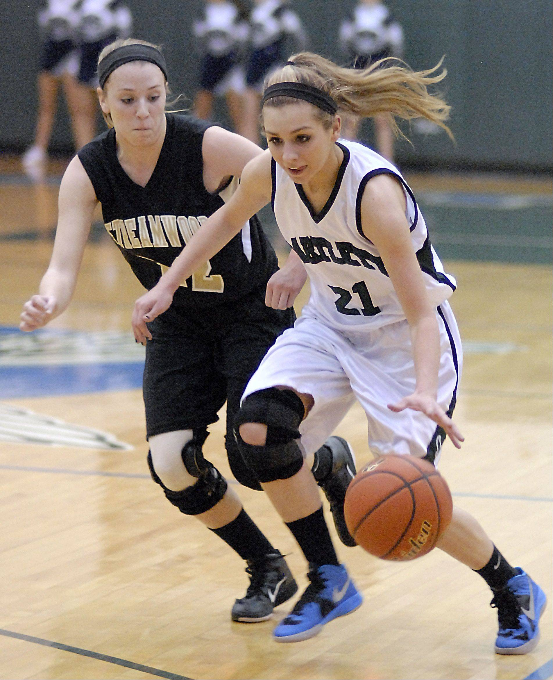 Bartlett's Chantel Zasada (21) dribbles against the defense of Streamwood's Holly Foret Wednesday night in Bartlett. Bartlett is the defending champion at the Dundee-Crown Charger Classic next week, while Streamwood travels to the Mundelein Holiday Tournament.