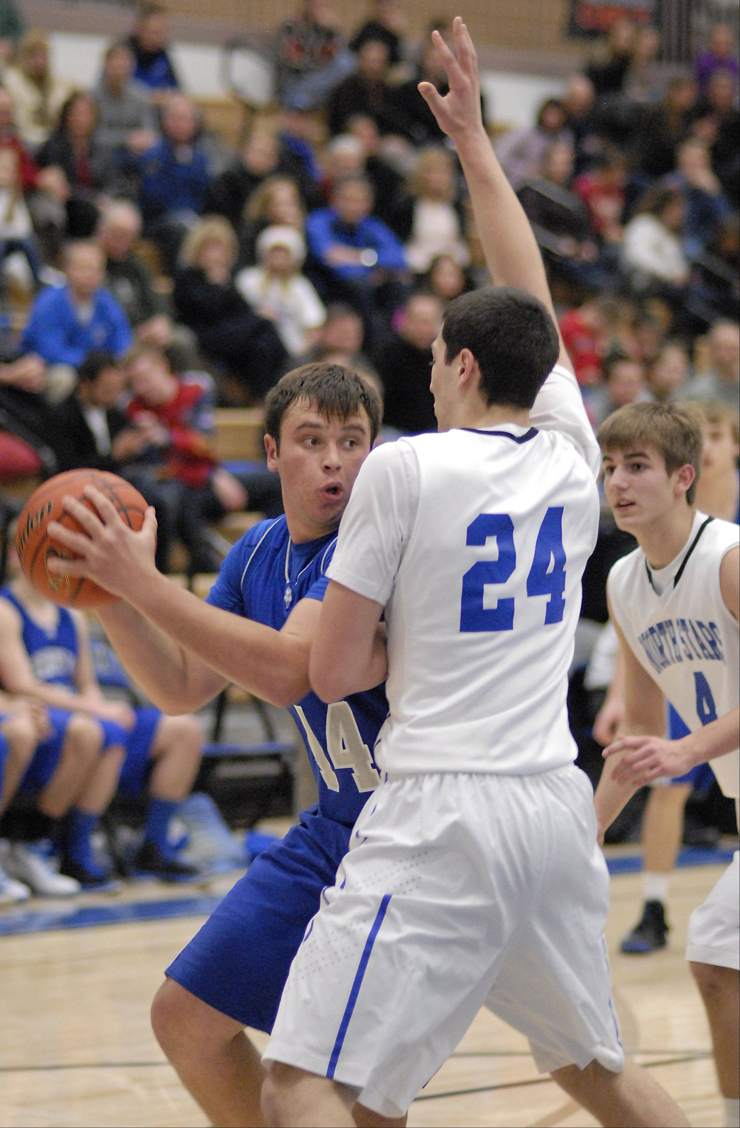 Geneva's Connor Chapman attempts to pass around St. Charles North's Chris Preocanin in the third quarter on Friday, December 21.