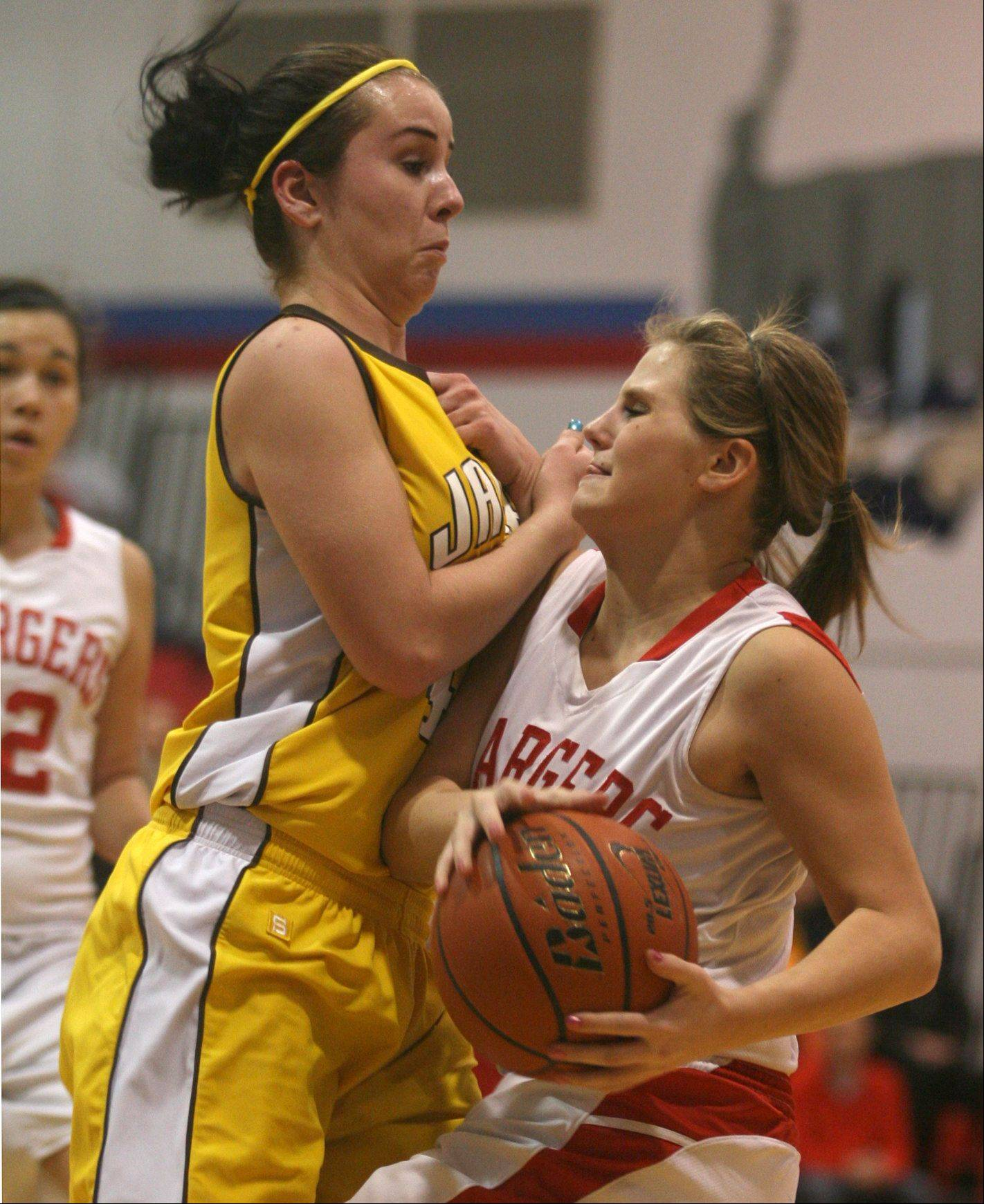 Jacobs' Jackie Bartolai, left, tries to stop Dundee-Crown's Stephanie Magsamen Friday night at D-C.