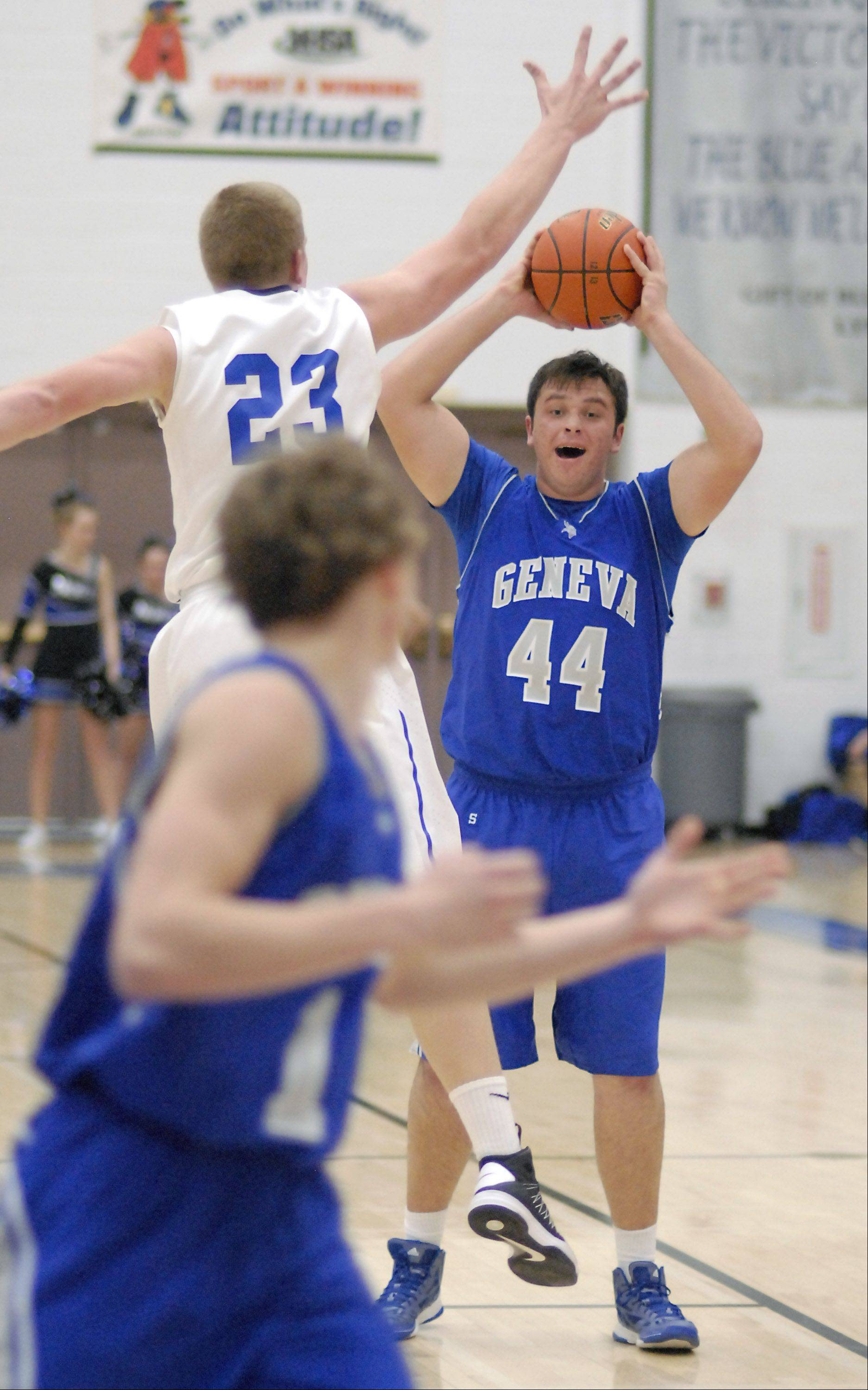 Geneva's Connor Chapman attempts to pass around a block by St. Charles North's Justin Stanko in the third quarter.