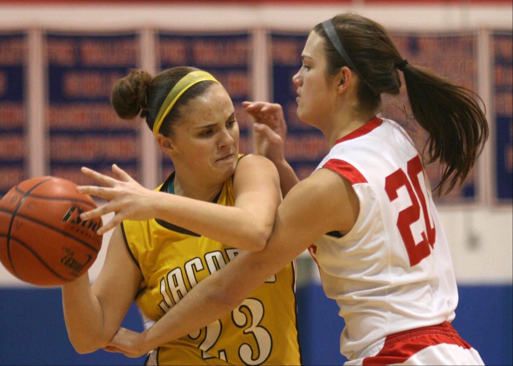 Jacobs' Tiffany Frighetto, left, tries to get past Dundee-Crown's Franchesca Cavallaro.