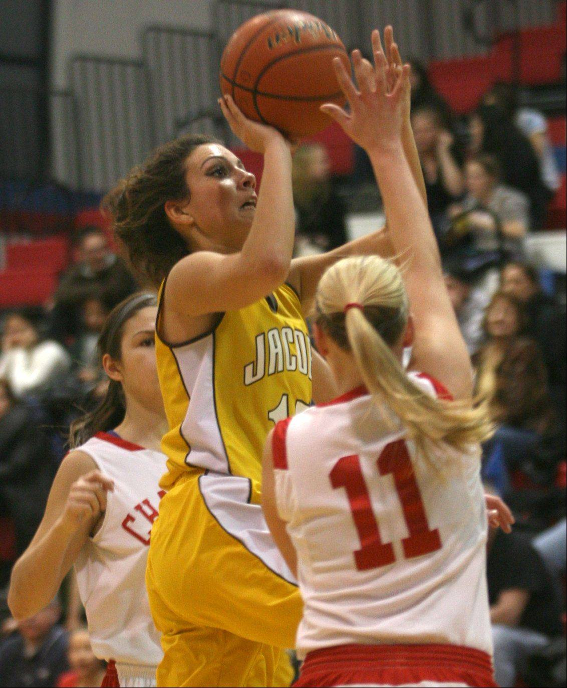 Jacobs' Payton Berg drives with the basketball to the hoop against Dundee-Crown.