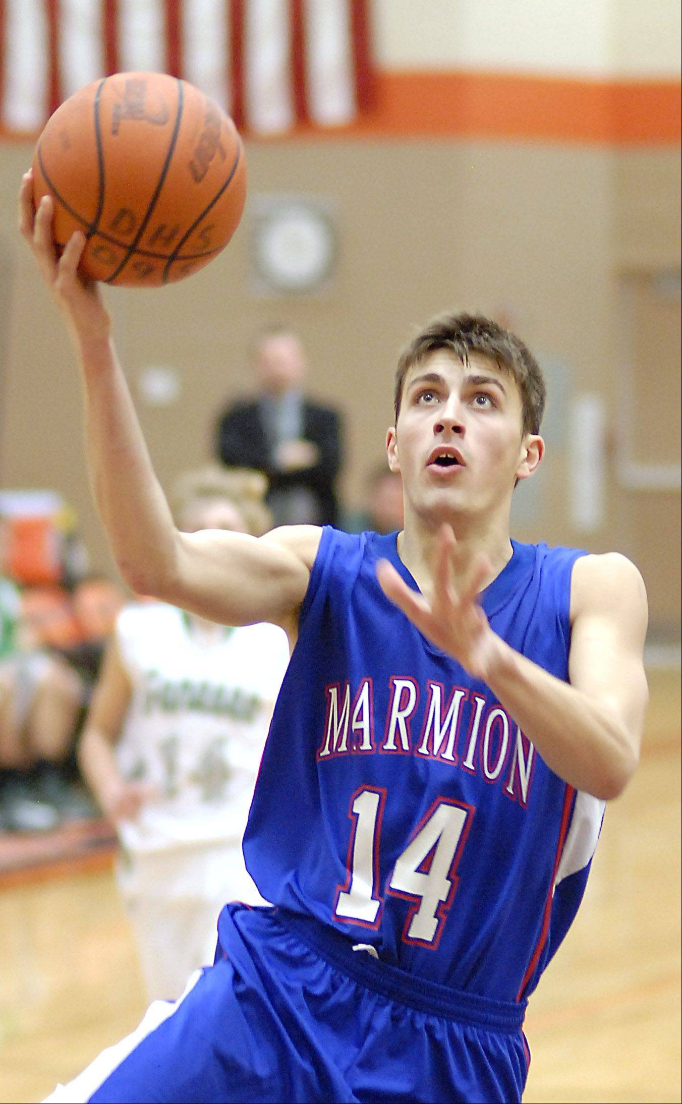 Marmion's Alex Theisen sinks a shot in the fourth quarter of the DeKalb tournament on Saturday, December 22.