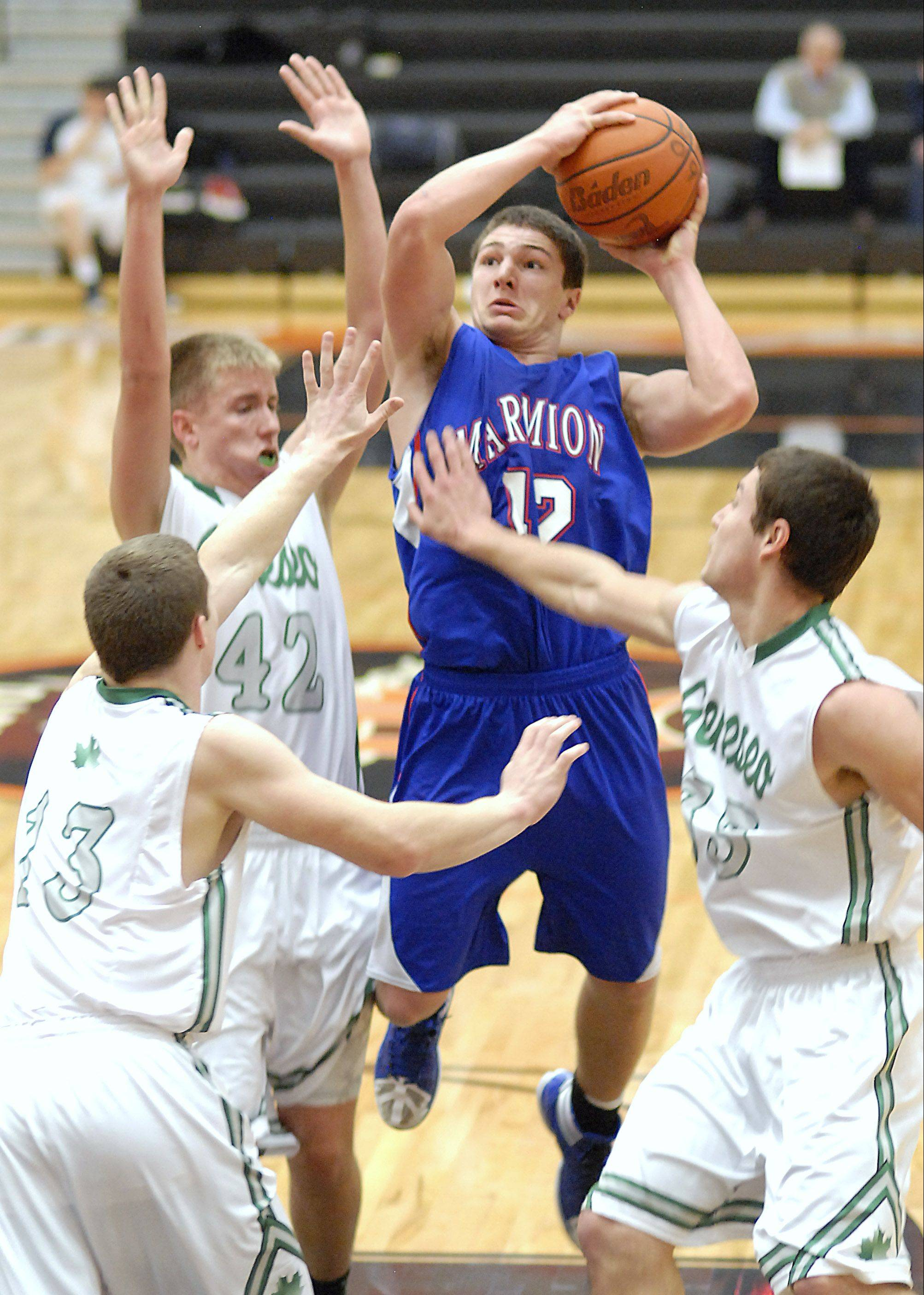 Marmion's Jordan Glasgow shoots over Geneseo at the DeKalb tournament on Saturday.