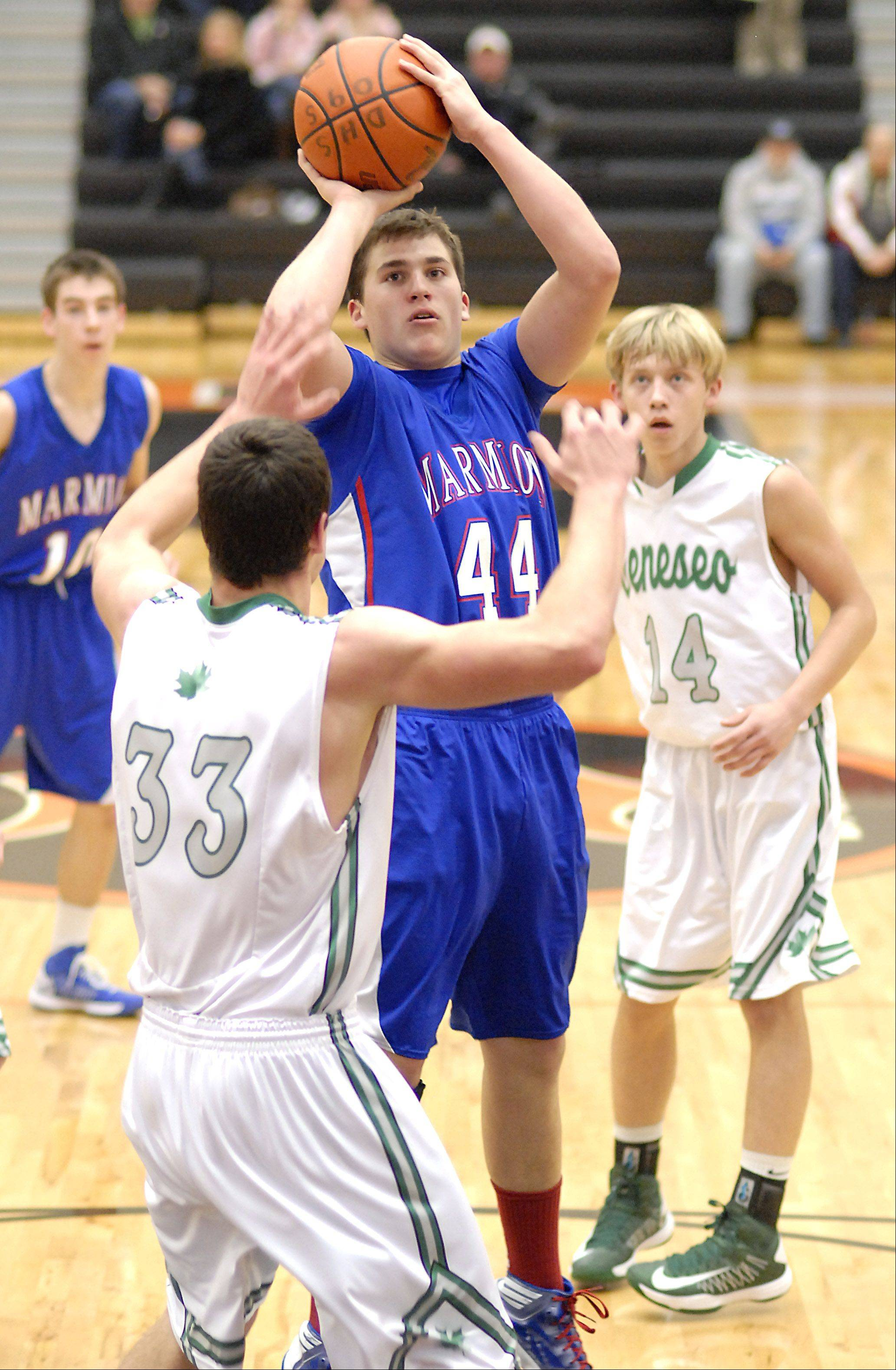 Marmion's Danny Bicknell shoots over Geneseo's Grant Burress in the second quarter of the DeKalb tournament on Saturday, December 22.
